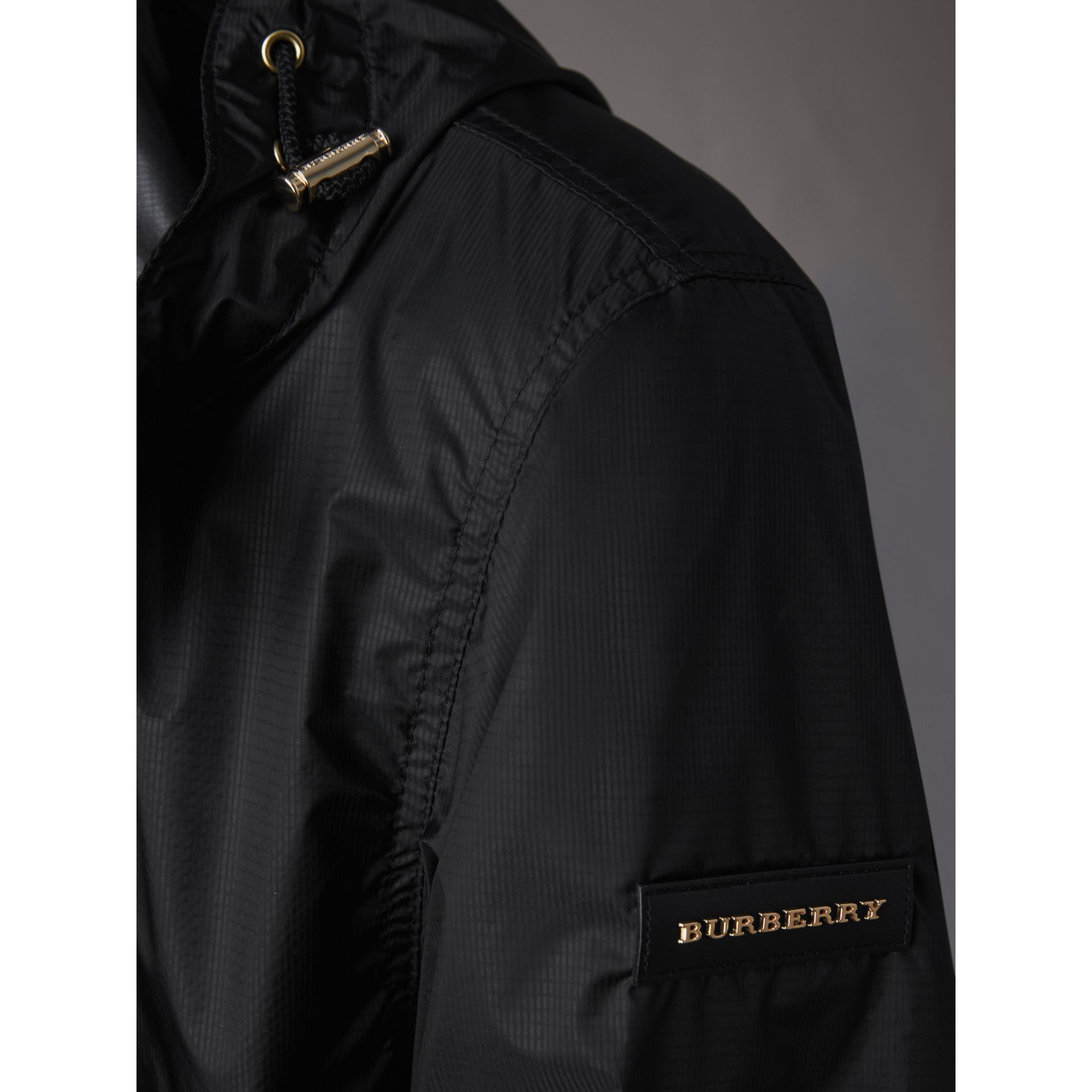 Hooded Super-lightweight Jacket in Black - Men | Burberry - gallery image 1