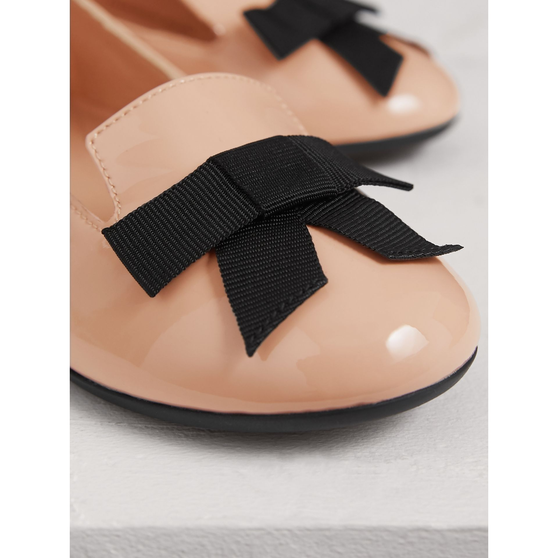 Bow Detail Patent Leather Ballerinas in Apricot Pink - Girl | Burberry - gallery image 2