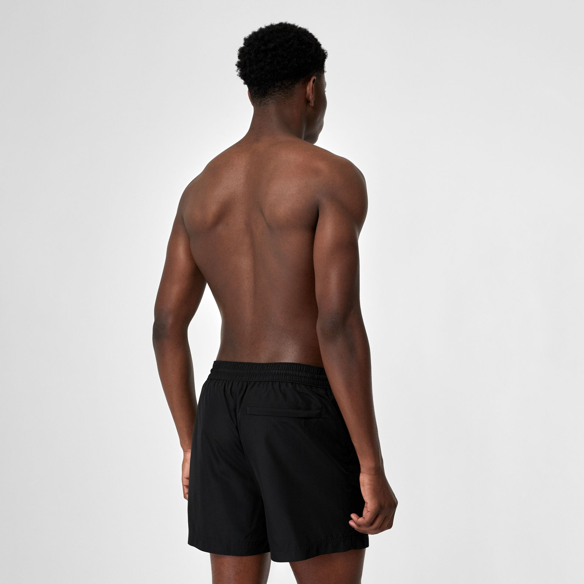 Logo Detail Drawcord Swim Shorts in Black - Men | Burberry - gallery image 1
