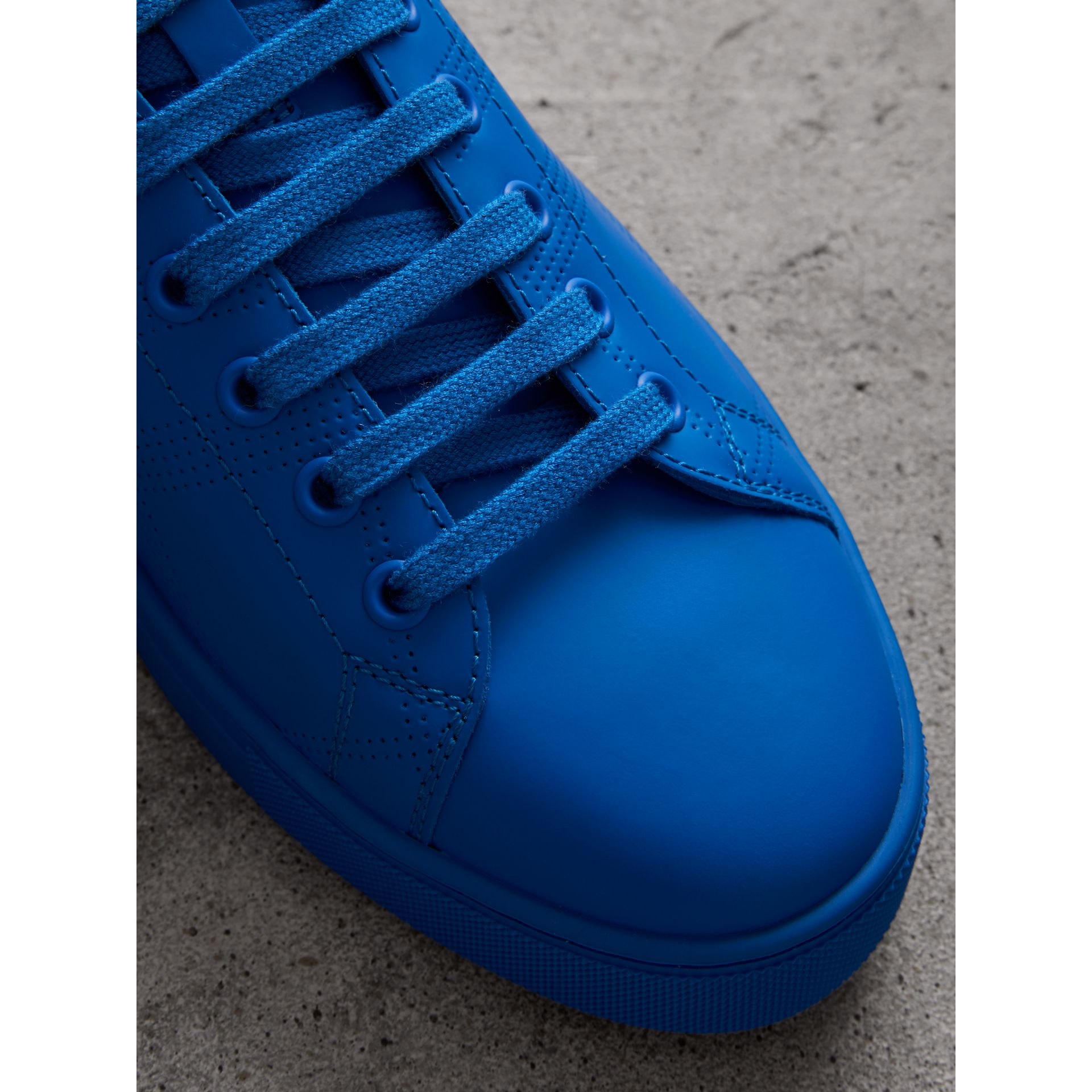 Perforated Check Leather Sneakers in Bright Sky Blue - Men | Burberry - gallery image 1