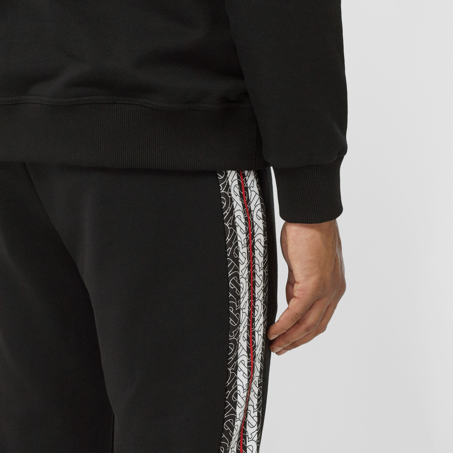 Monogram Stripe Panel Cotton Trackpants in Black - Men | Burberry - gallery image 1