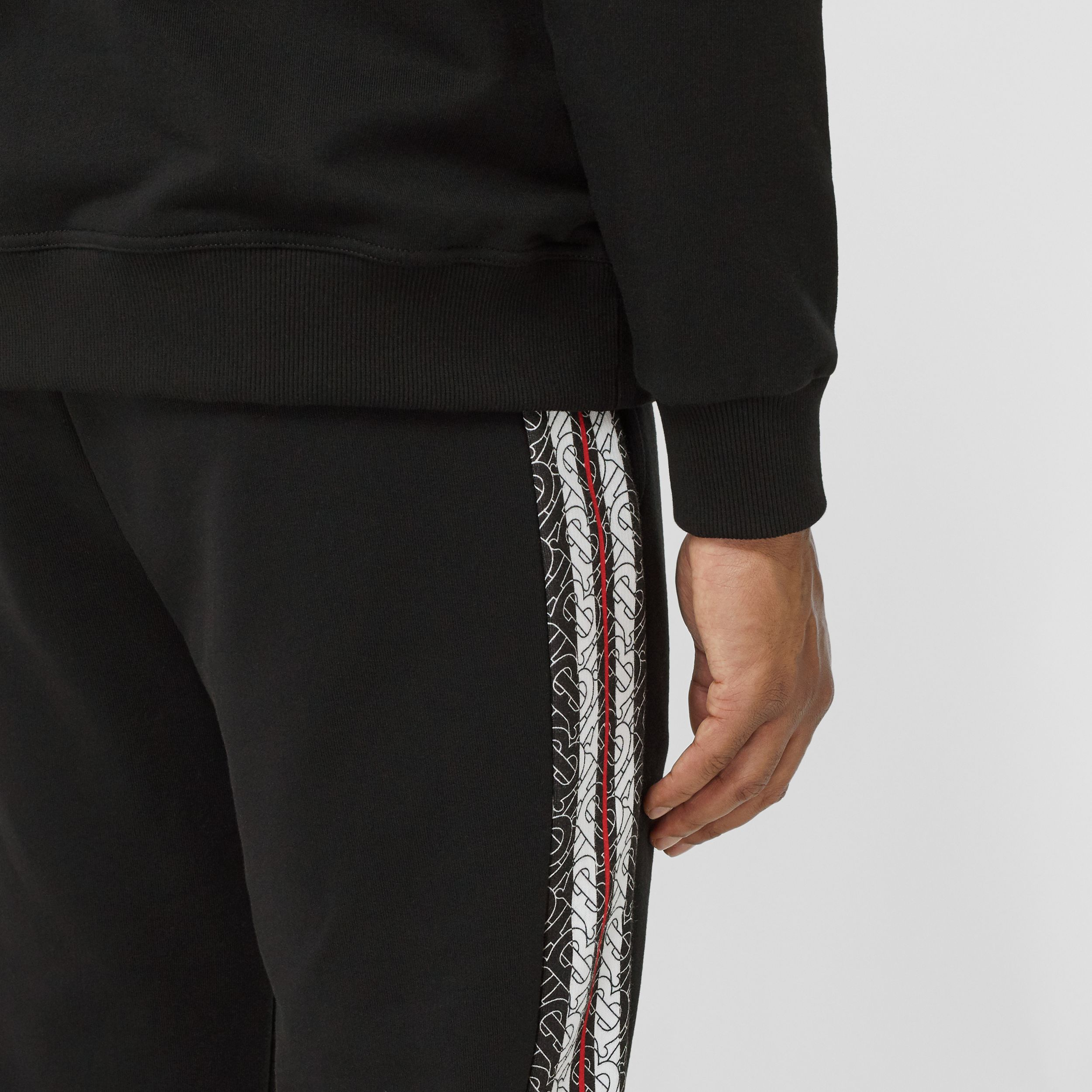 Monogram Stripe Panel Cotton Jogging Pants in Black - Men | Burberry - 2
