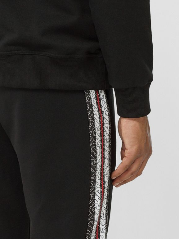Monogram Stripe Panel Cotton Trackpants in Black - Men | Burberry - cell image 1