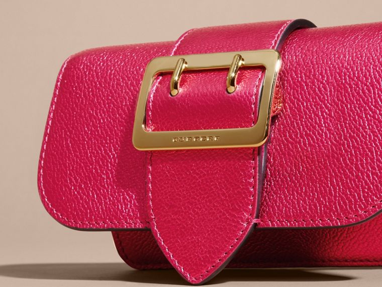 The Mini Buckle Bag in Metallic Grainy Leather in Bright Pink - cell image 1