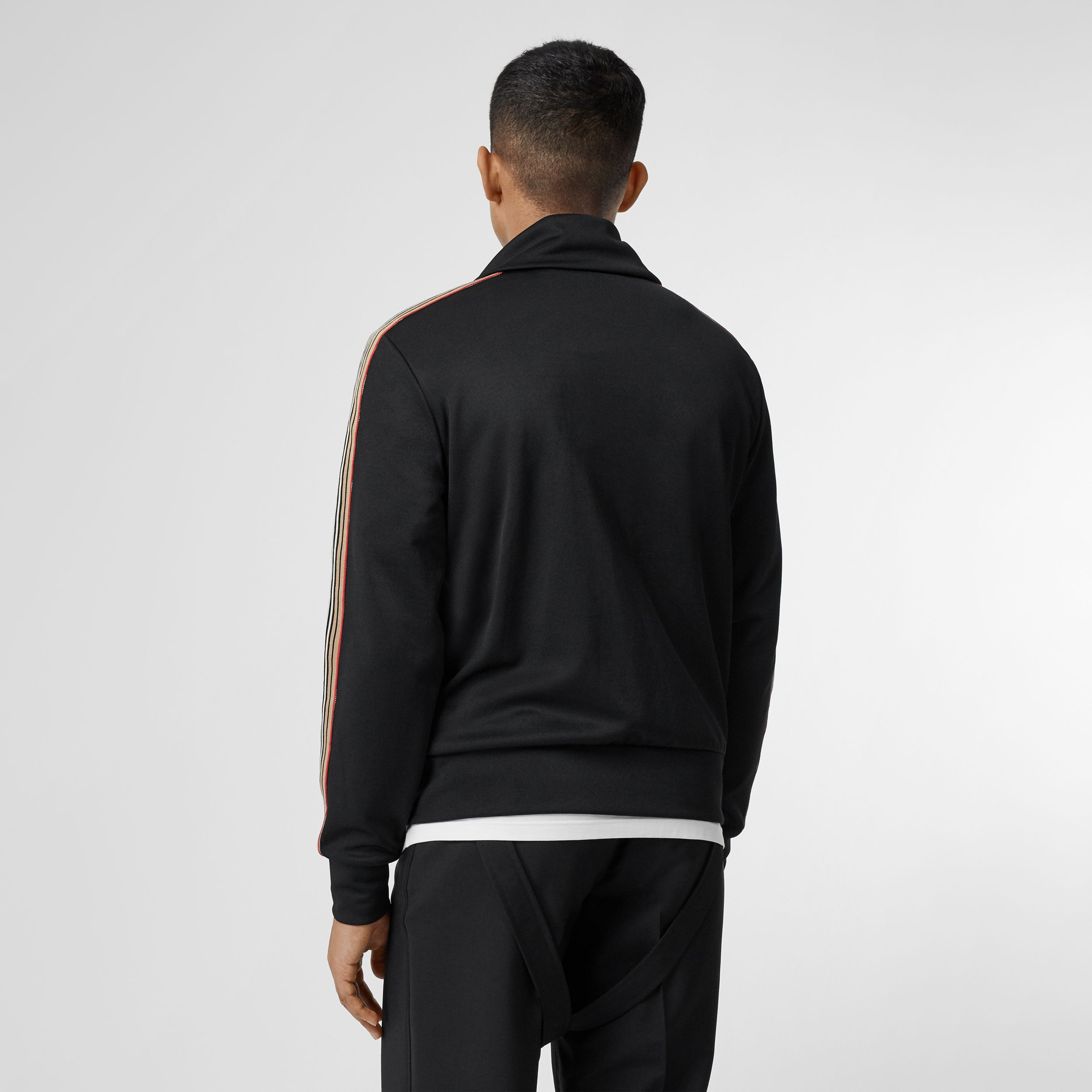 Icon Stripe Detail Funnel Neck Track Top in Black - Men | Burberry - 3