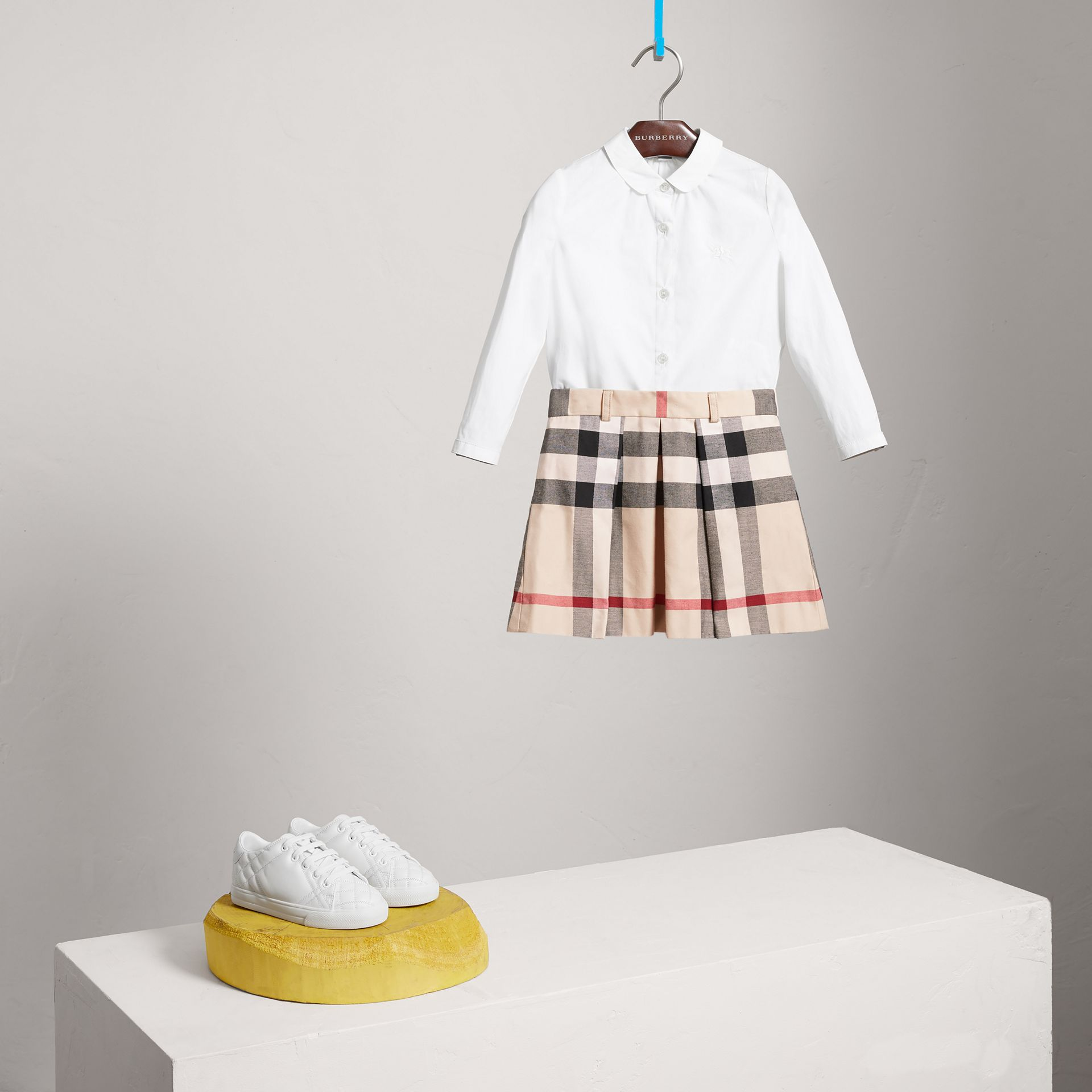 Pleated Check Cotton Skirt in Stone - Girl | Burberry Canada - gallery image 0