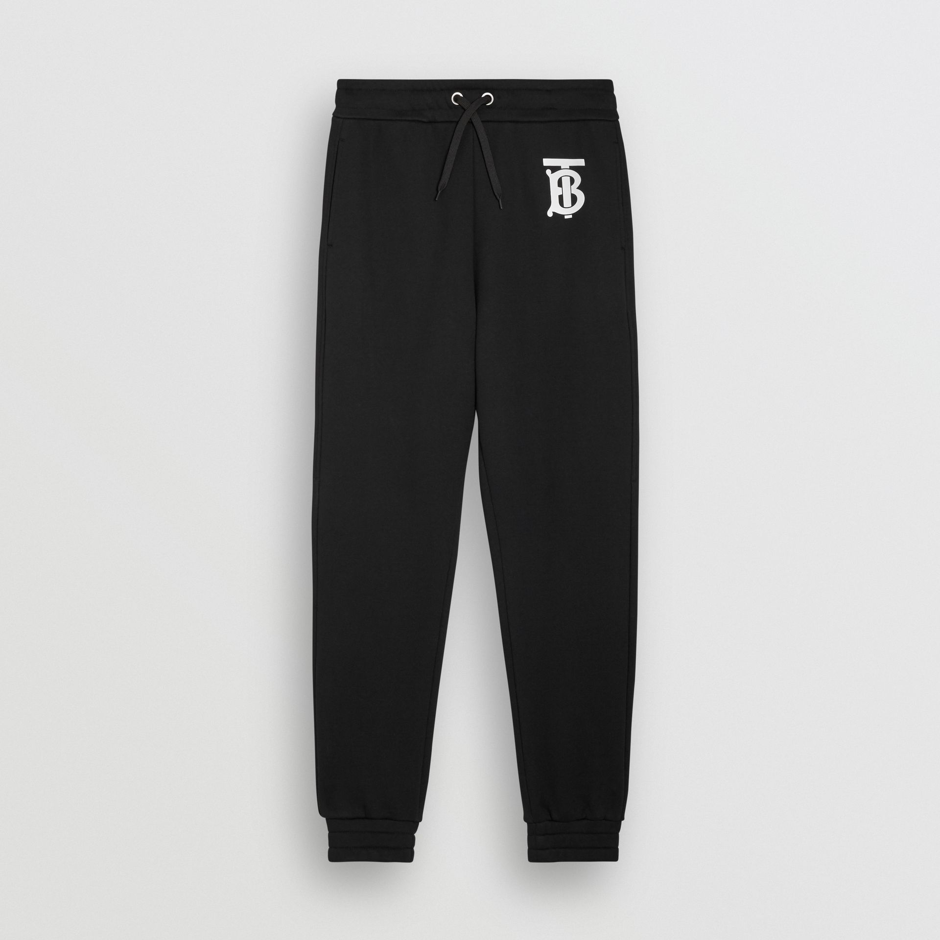 Monogram Motif Cotton Trackpants in Black - Men | Burberry United States - gallery image 1