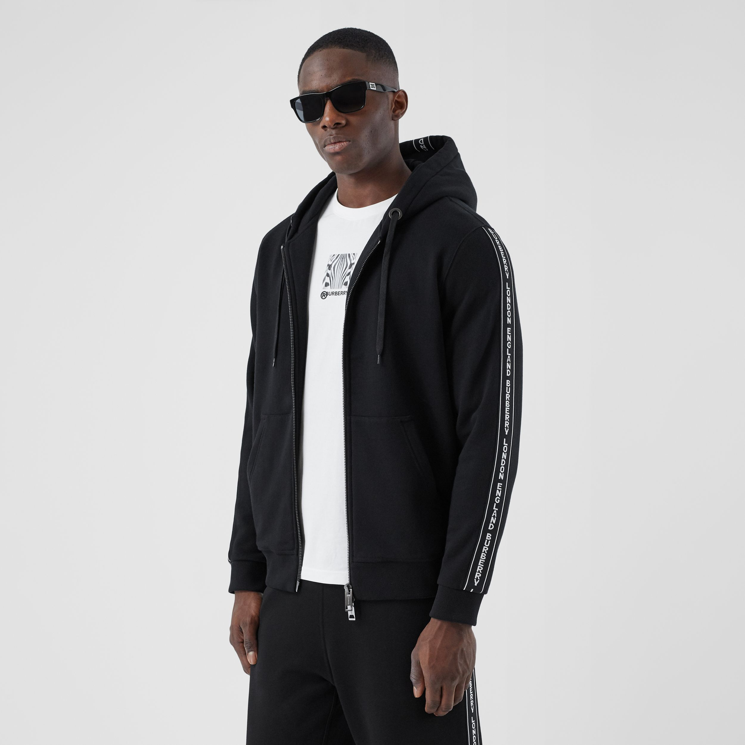 Logo Tape Cotton Hooded Top in Black - Men | Burberry Australia - 1