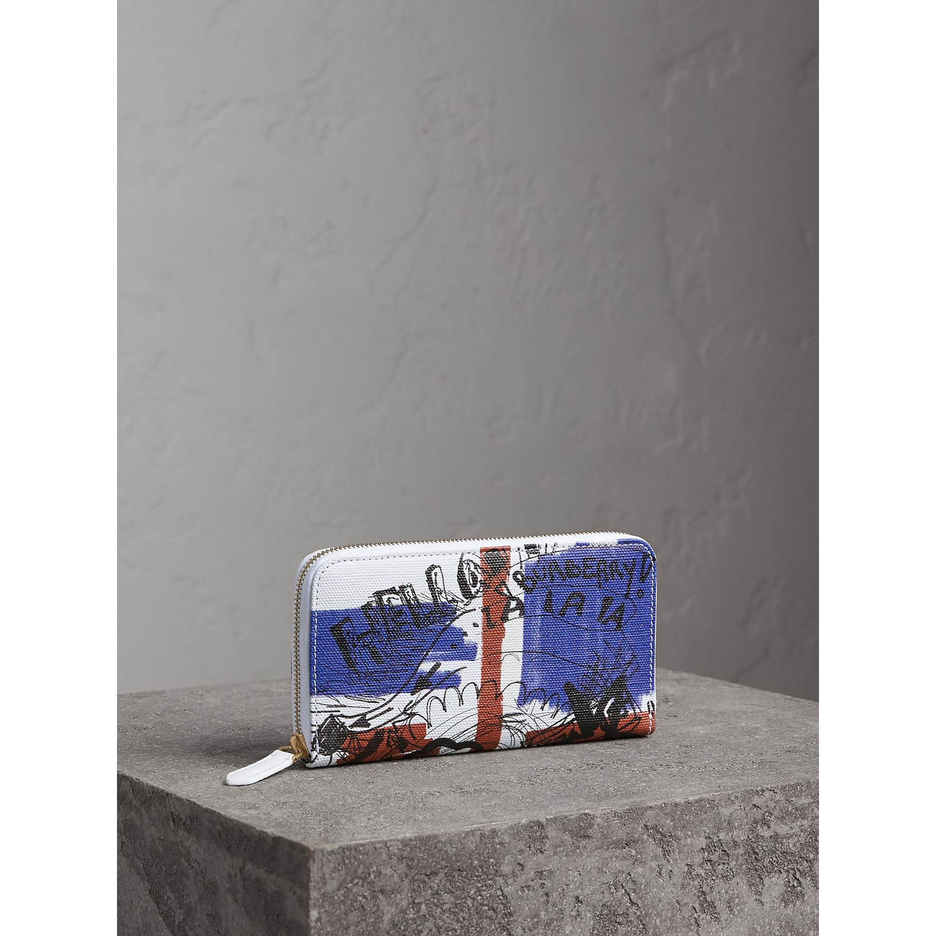 Doodle Print Coated Canvas Ziparound Wallet in Red/blue | Burberry - gallery image 1