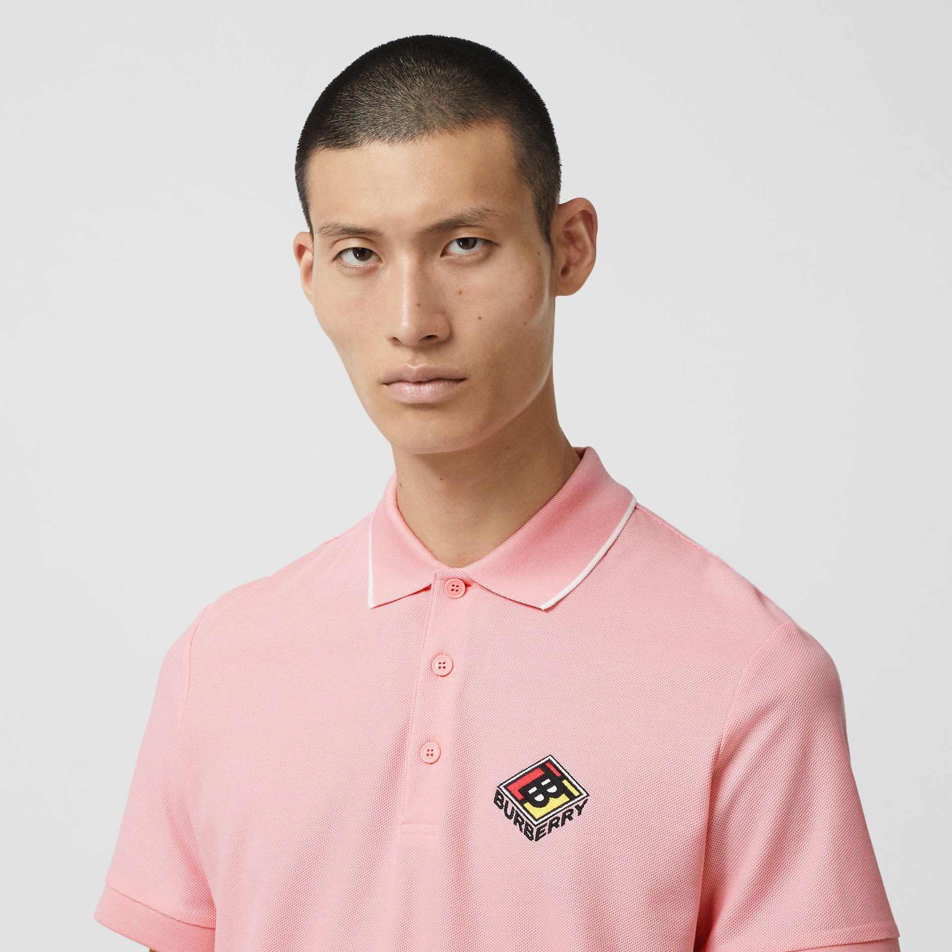 Logo Graphic Cotton Piqué Polo Shirt in Candy Pink - Men | Burberry - gallery image 1