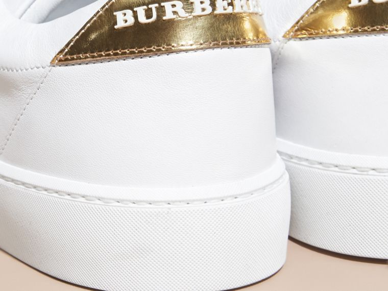 Metallic Detail Leather Trainers in Antique Gold/optic White - Women | Burberry - cell image 1