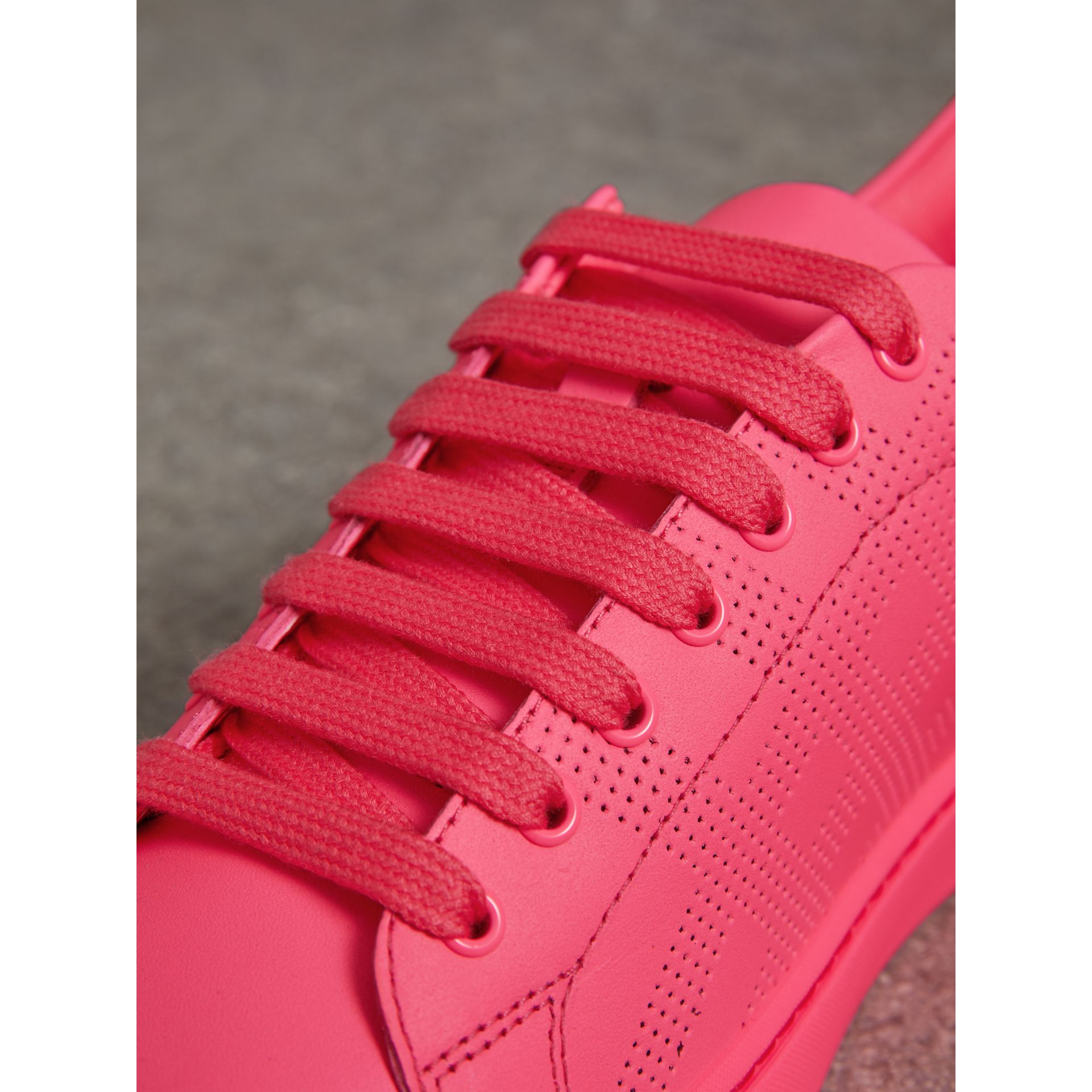 Perforated Check Leather Sneakers in Neon Pink - Women | Burberry - gallery image 1