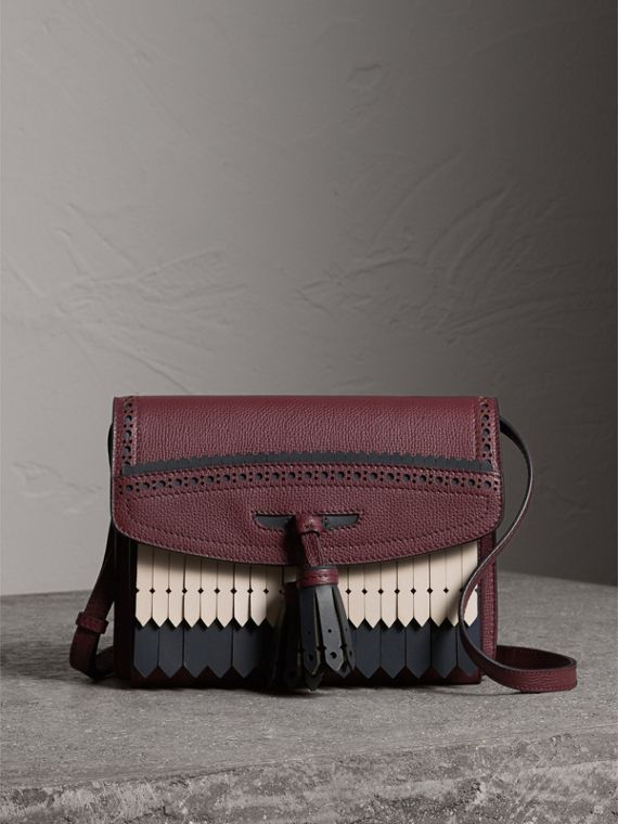 Brogue and Fringe Detail Leather Crossbody Bag in Mahogany Red