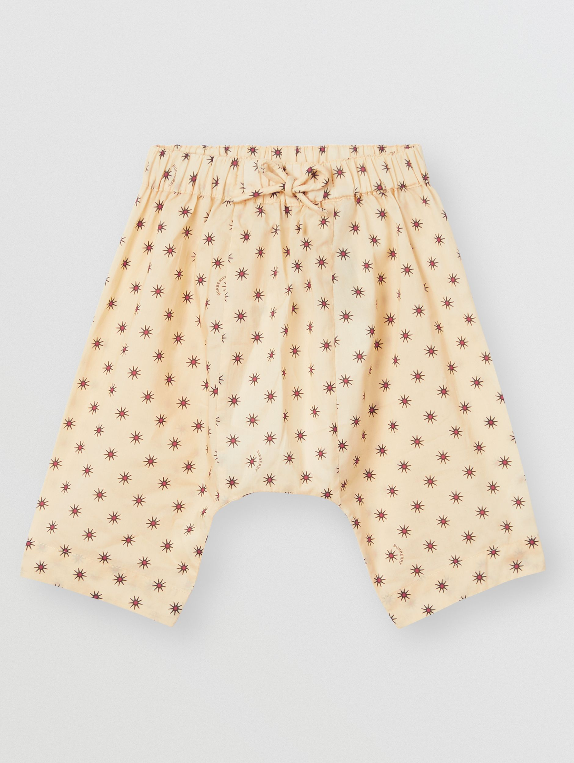 Star Print Cotton Drawcord Trousers in Military Red - Children | Burberry - 1