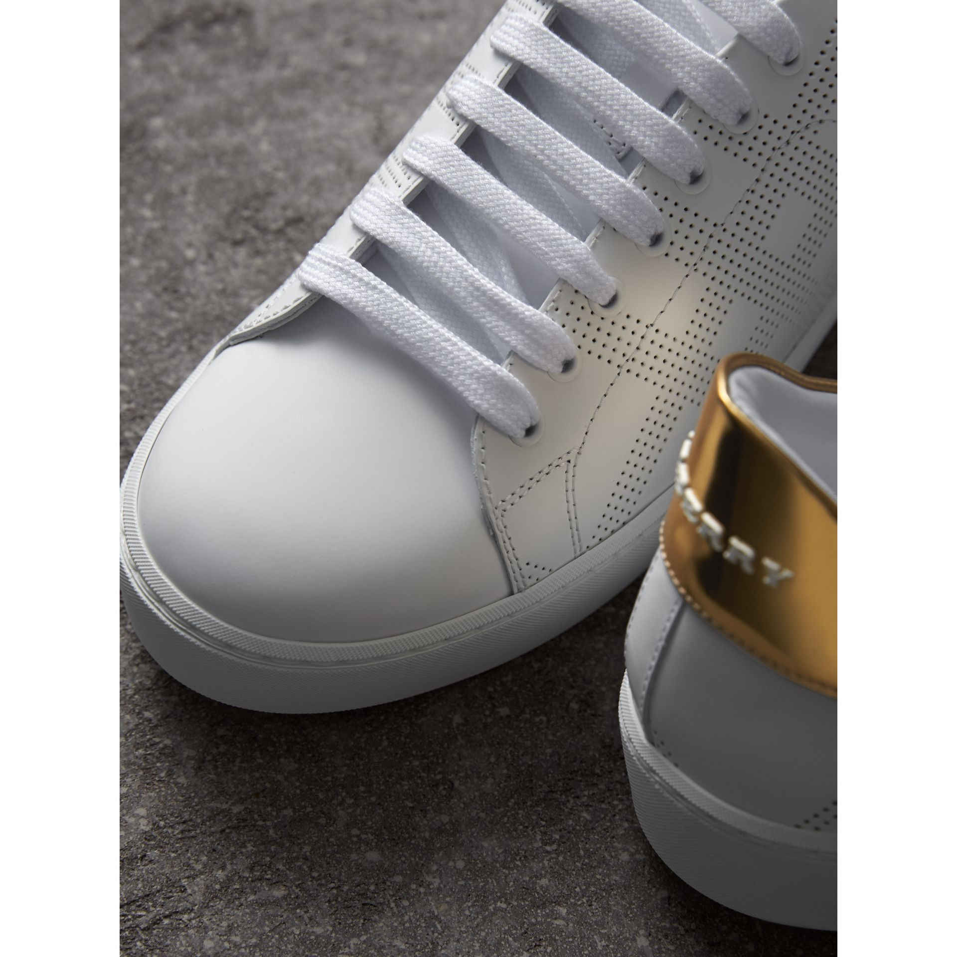 Perforated Check Leather Trainers in Optic White - Women | Burberry United Kingdom - gallery image 2