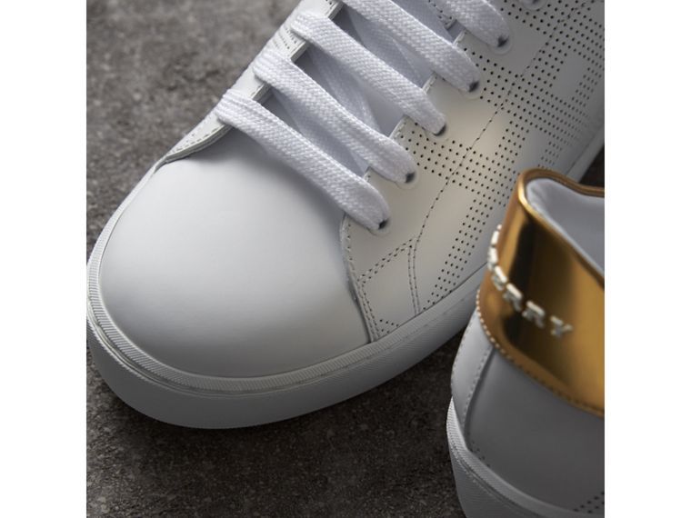 Perforated Check Leather Trainers in Optic White - Women | Burberry United Kingdom - cell image 1