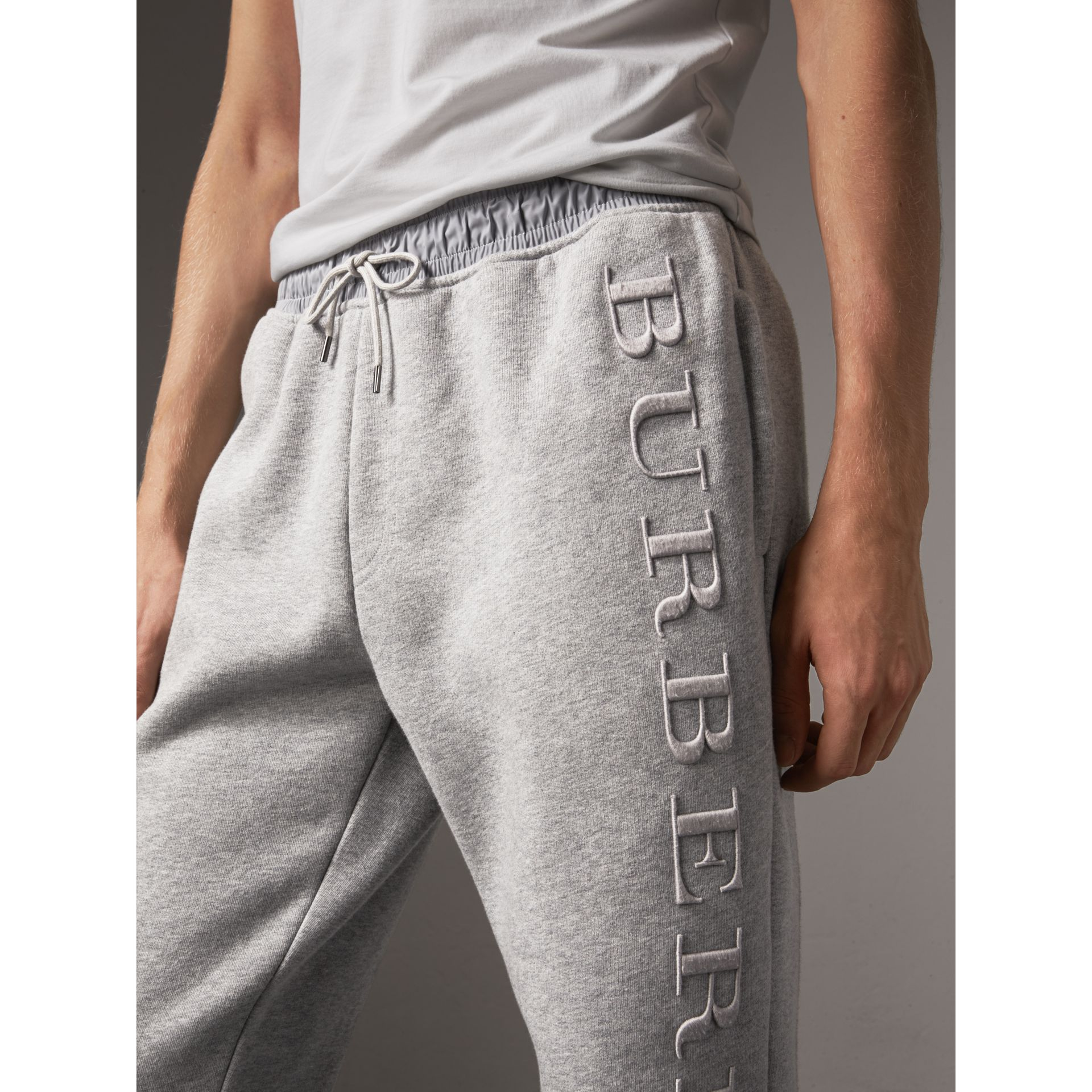 Embroidered Jersey Sweatpants in Pale Grey Melange - Men | Burberry Hong Kong - gallery image 1