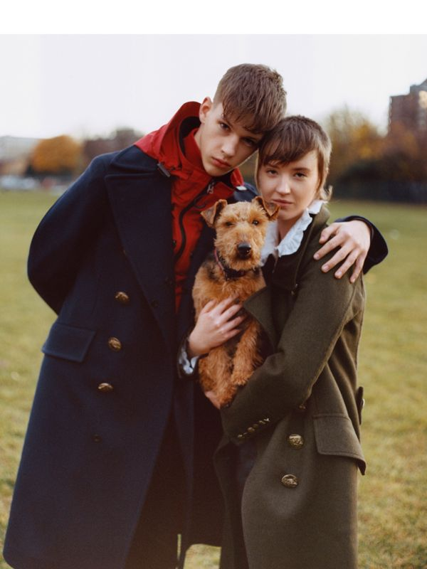Sam and Molly Dilkes with Tracy-Jane<br>Sam layers a cashmere-wool greatcoat over a red taffeta jacket. Molly wears a double-breasted military coat. Tracy-Jane wears The Burberry Bandana.