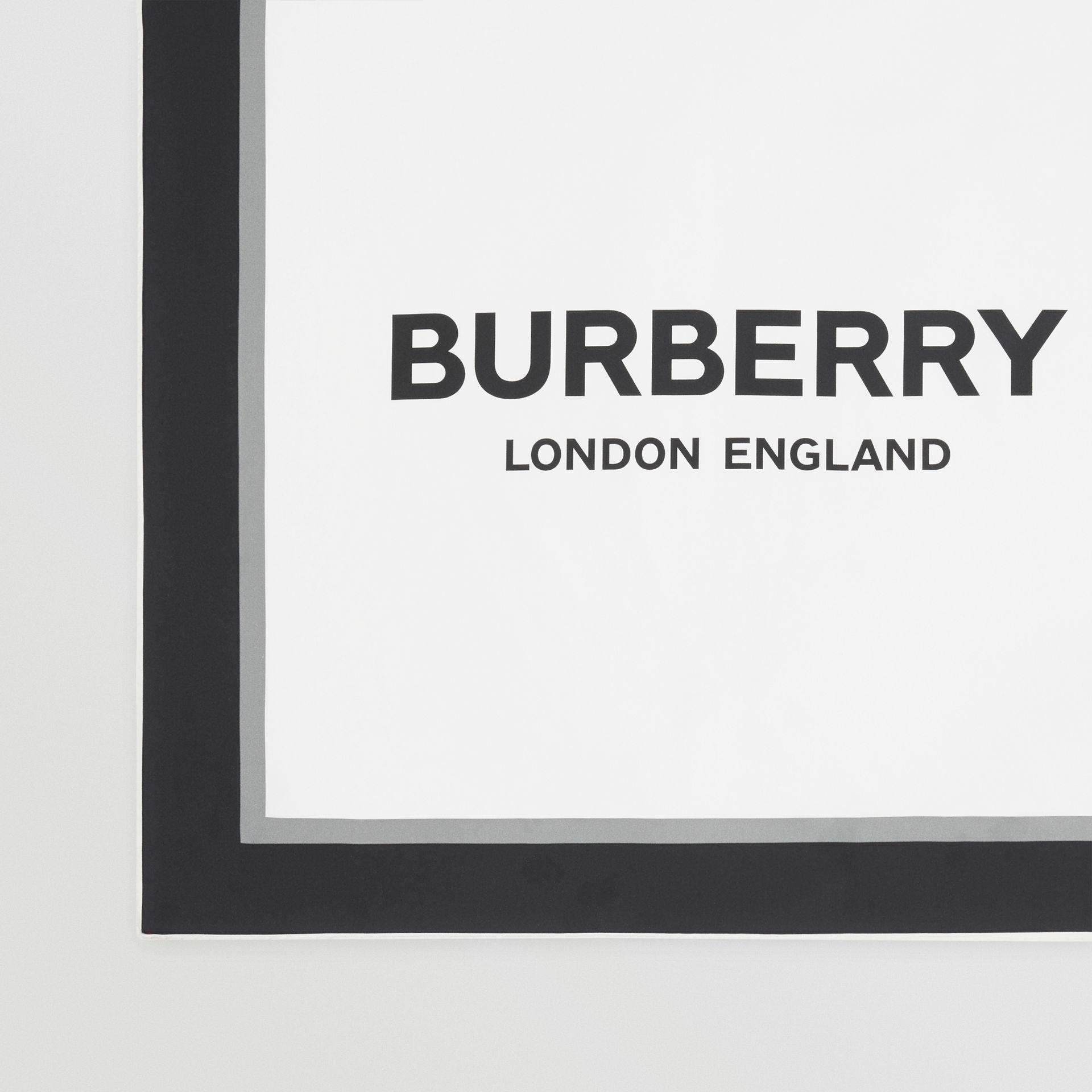 Montage and Logo Print Silk Scarf in Monochrome | Burberry - gallery image 1