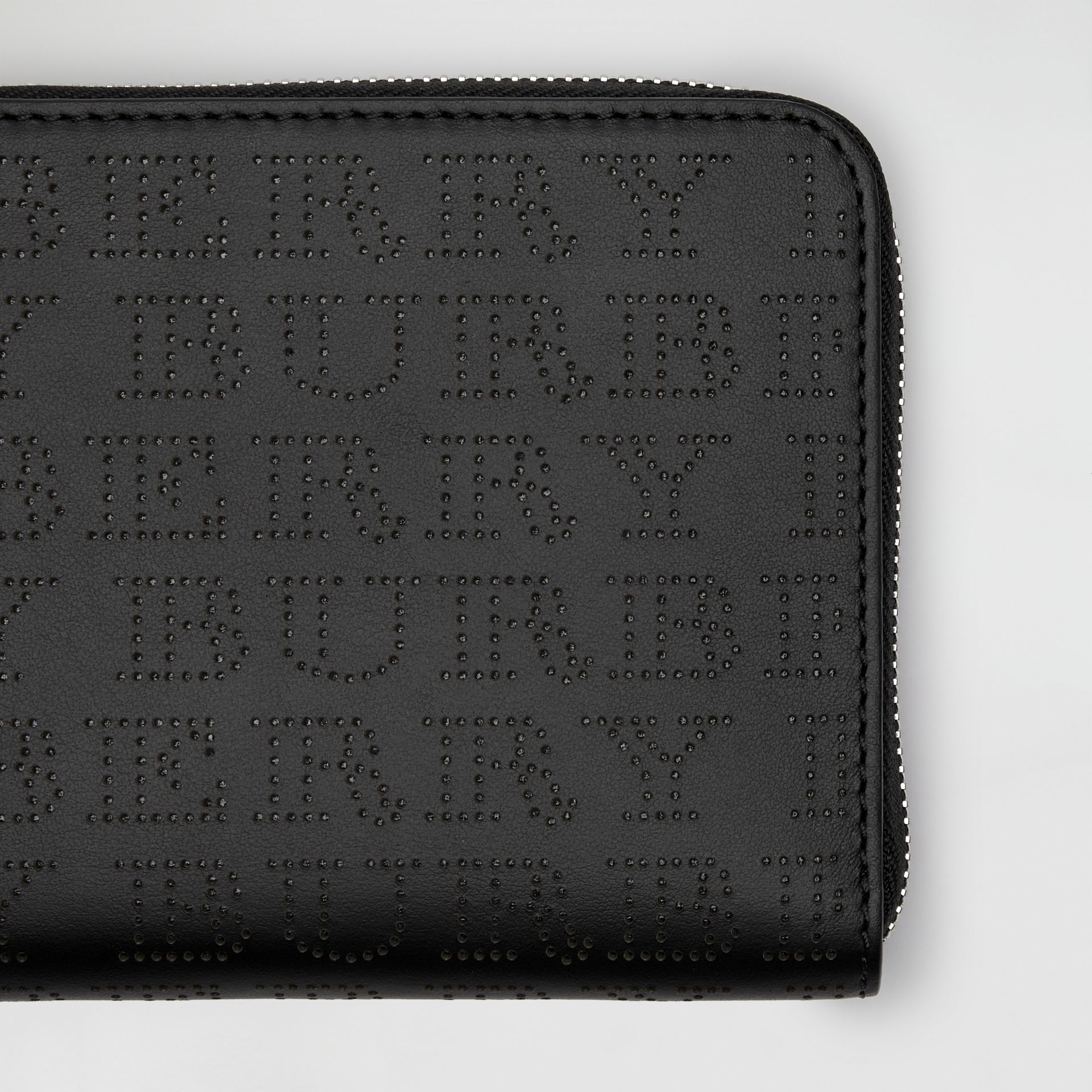 Perforated Logo Leather Ziparound Wallet in Black | Burberry Australia - gallery image 1