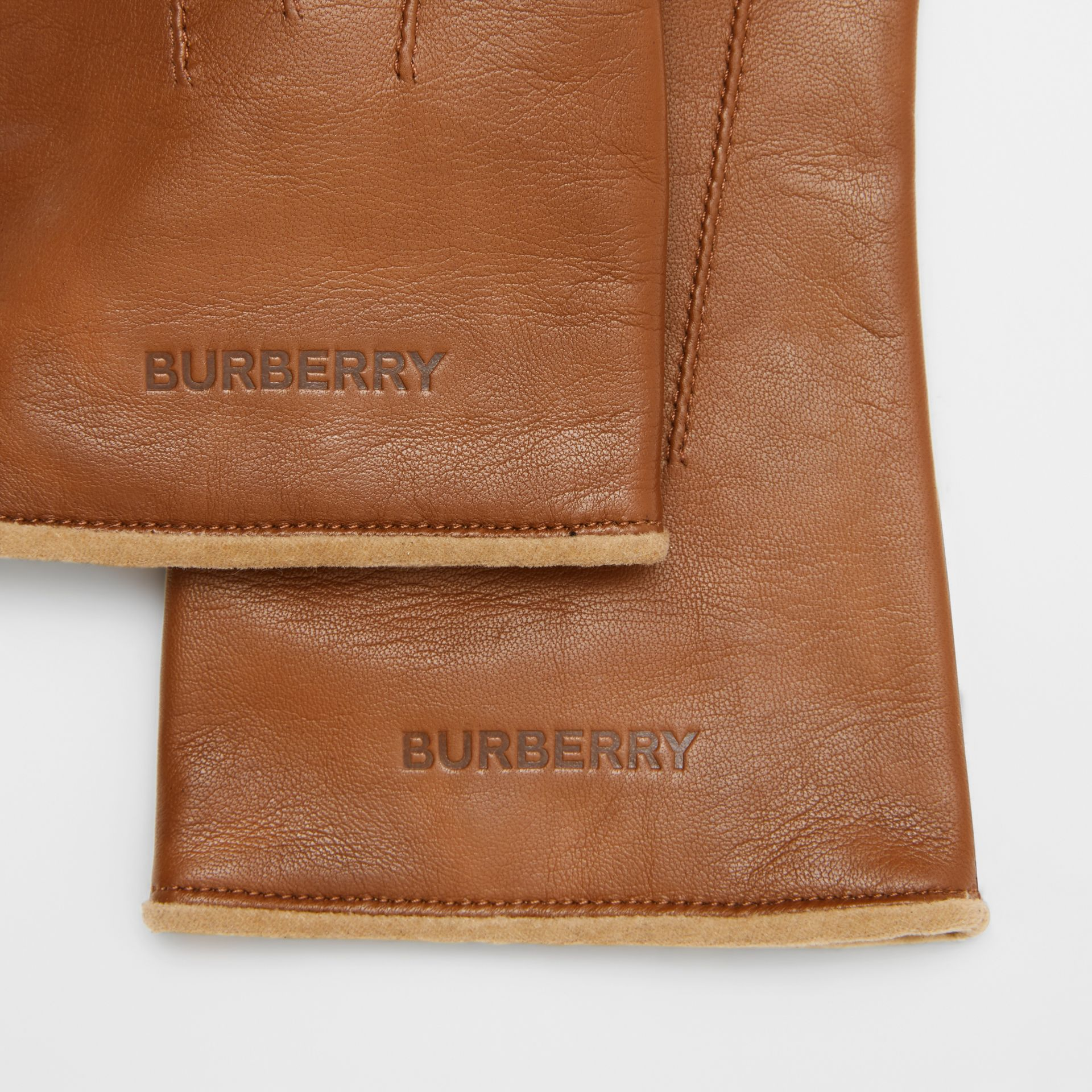Embossed Logo Cashmere-lined Lambskin Gloves in Brown | Burberry - gallery image 1