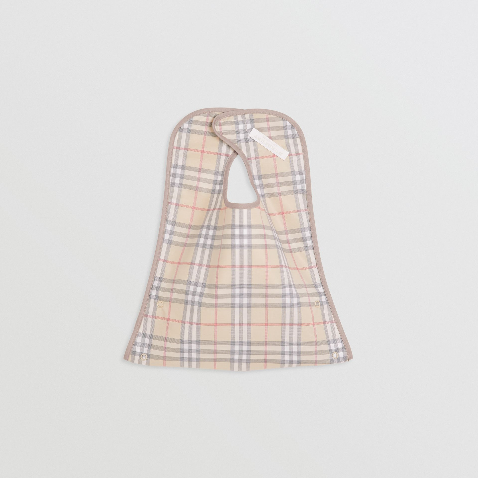 Coated Check Cotton Baby Bib in Pale Stone - Children | Burberry - gallery image 2