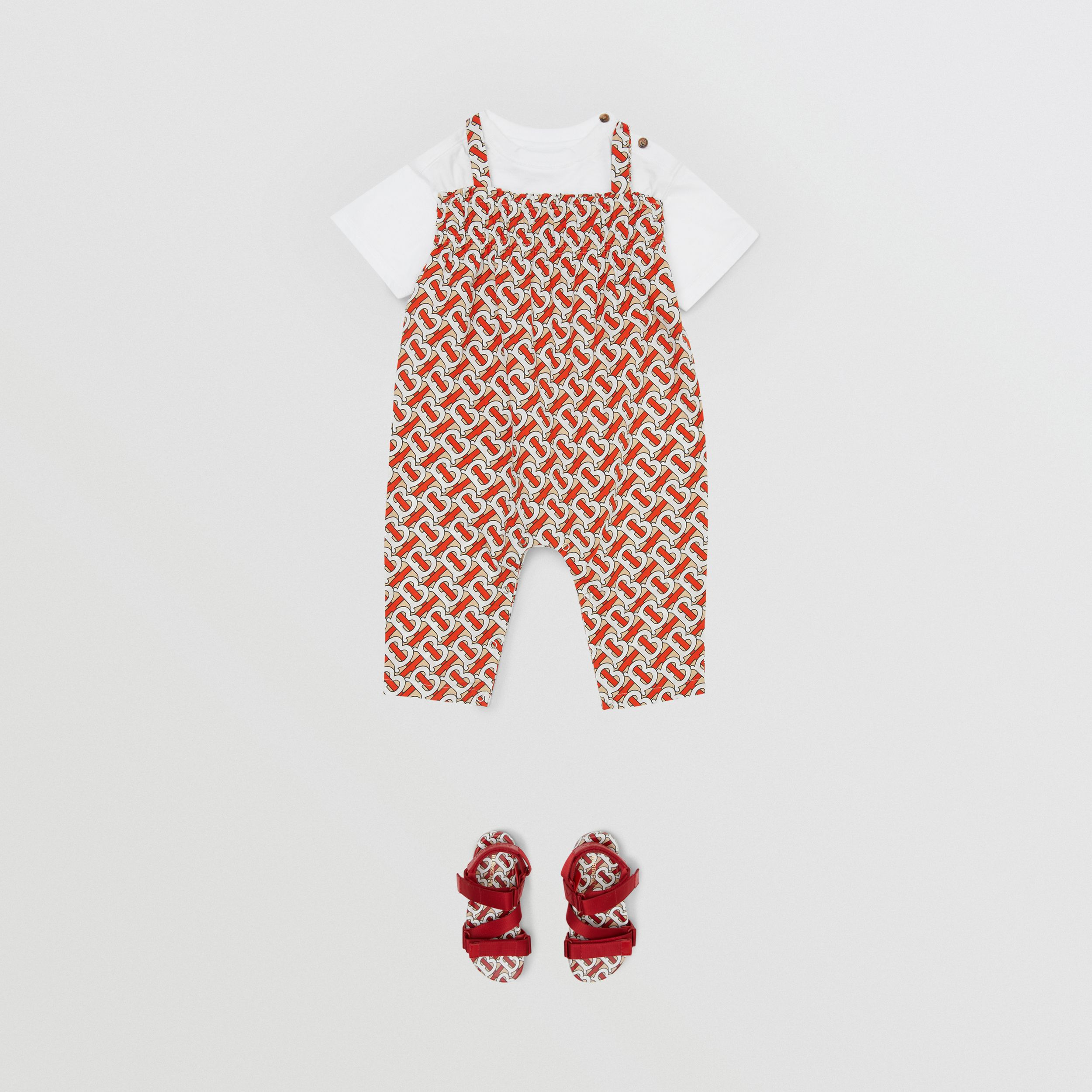 Smocked Monogram Print Cotton Poplin Jumpsuit in Vermilion Red - Children | Burberry - 3