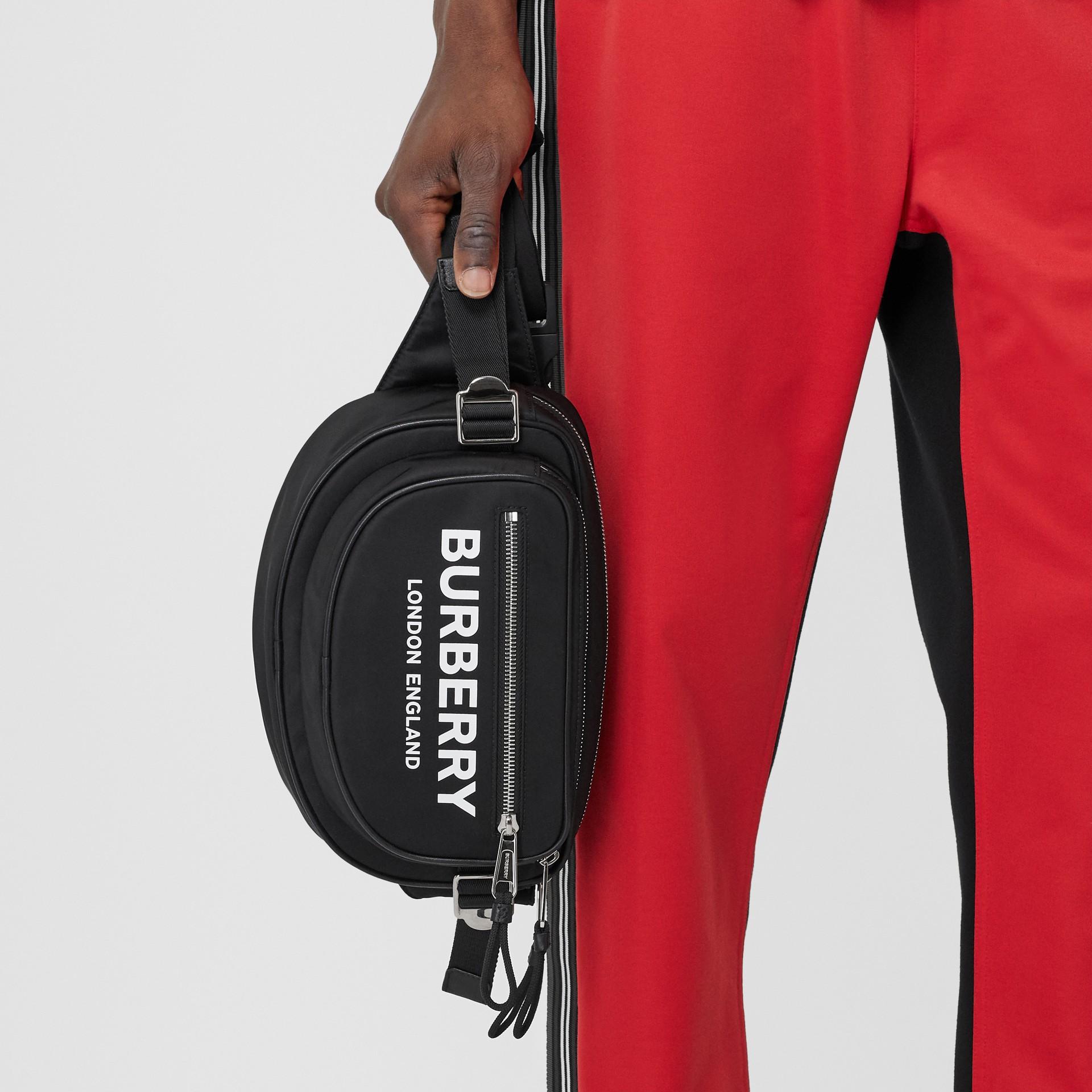 Medium Logo Print ECONYL® Cannon Bum Bag in Black - Men | Burberry United Kingdom - gallery image 10