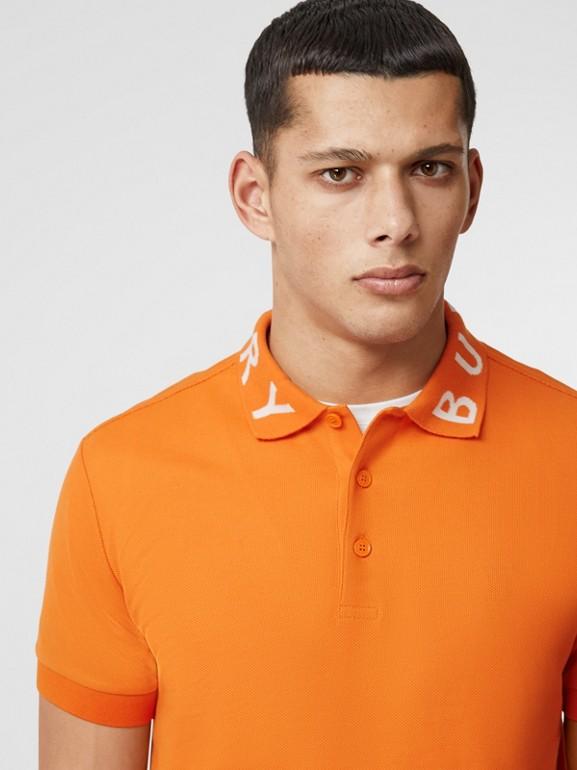 Polo in cotone piqué con logo a intarsio (Arancione Intenso) - Uomo | Burberry - cell image 1
