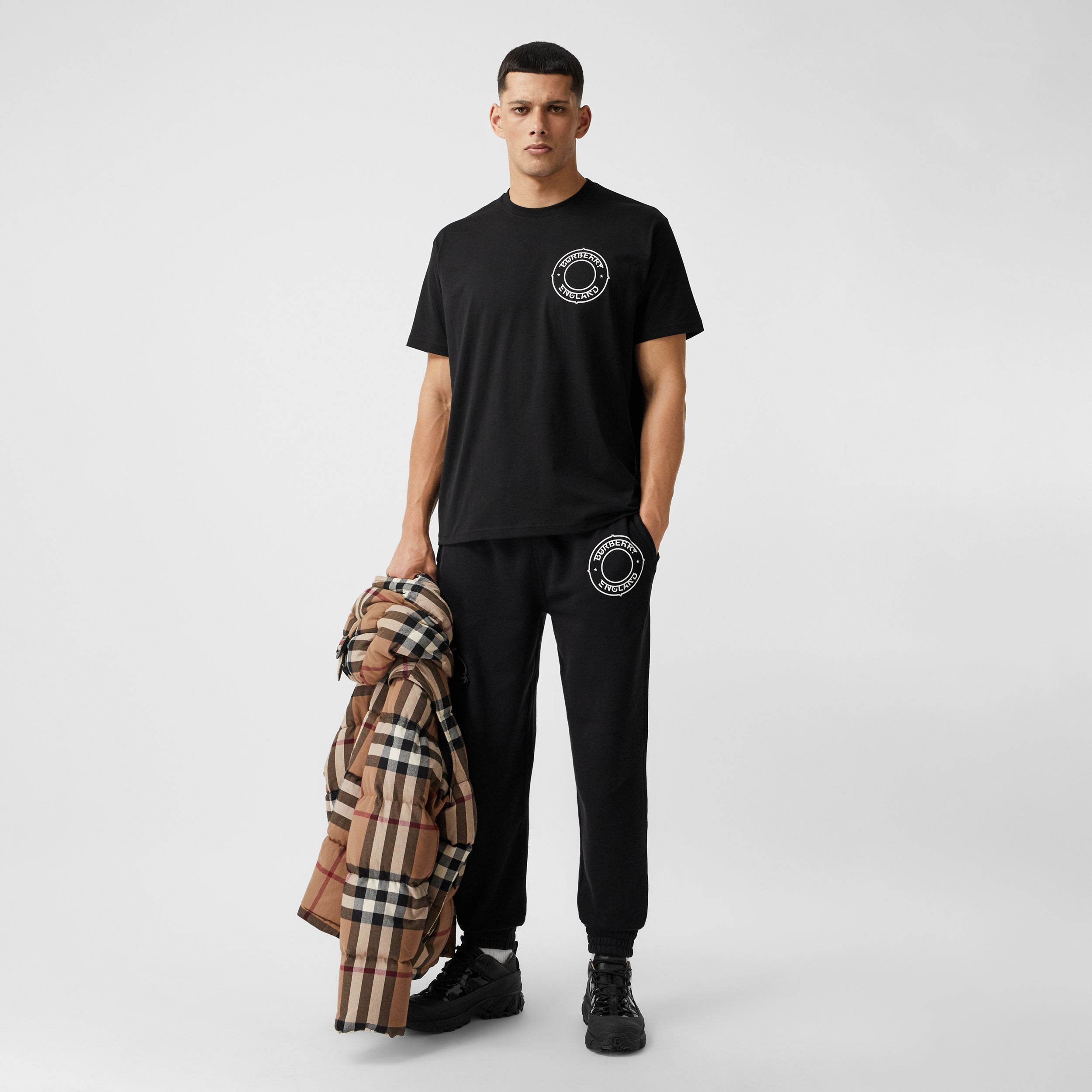 Logo Graphic Cotton Jogging Pants in Black - Men | Burberry - 1