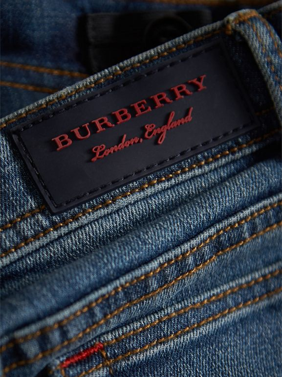 Skinny Fit Stretch Denim Jeans in Mid Indigo - Girl | Burberry United Kingdom - cell image 1