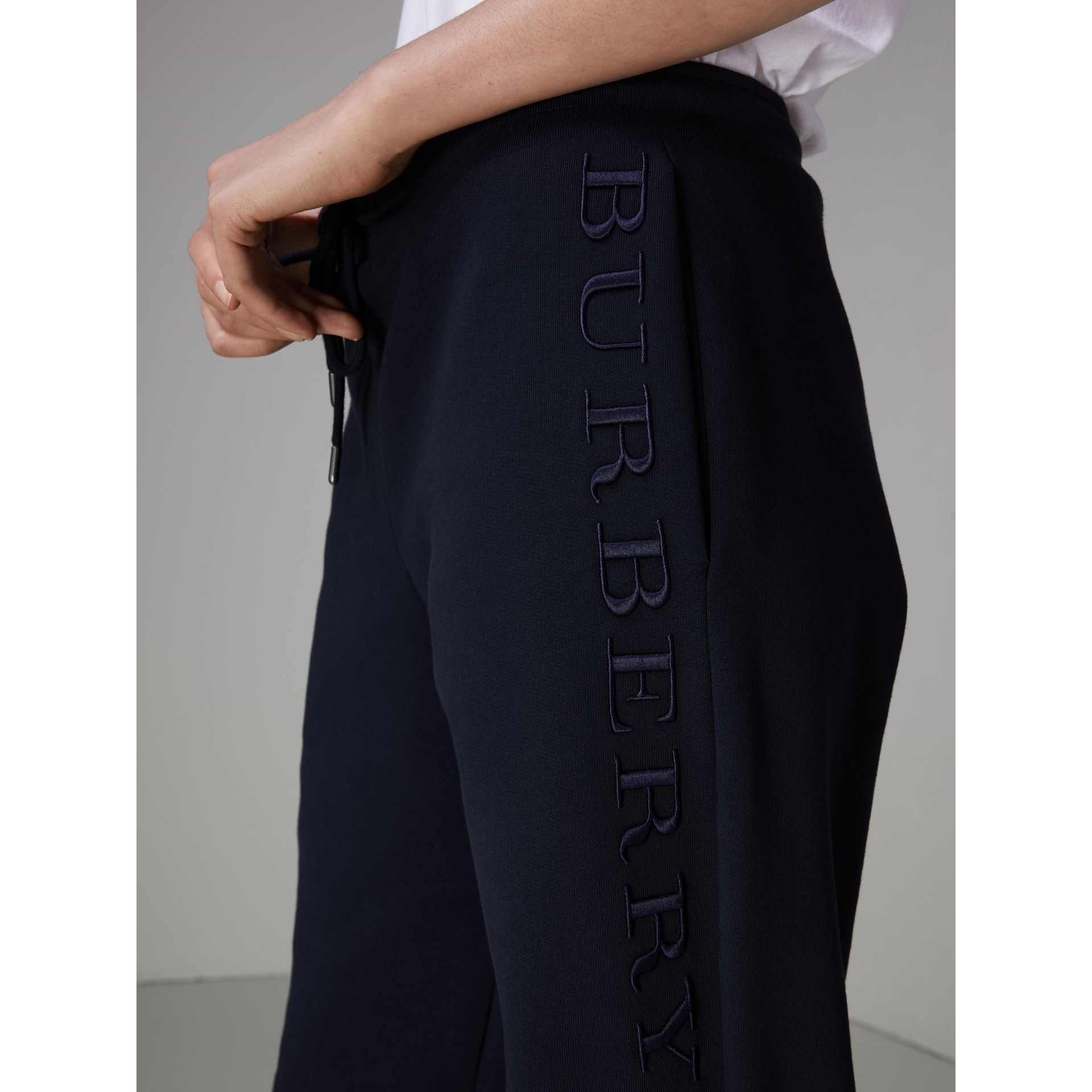 Embroidered Jersey Sweatpants in Navy - Women | Burberry United Kingdom - gallery image 1