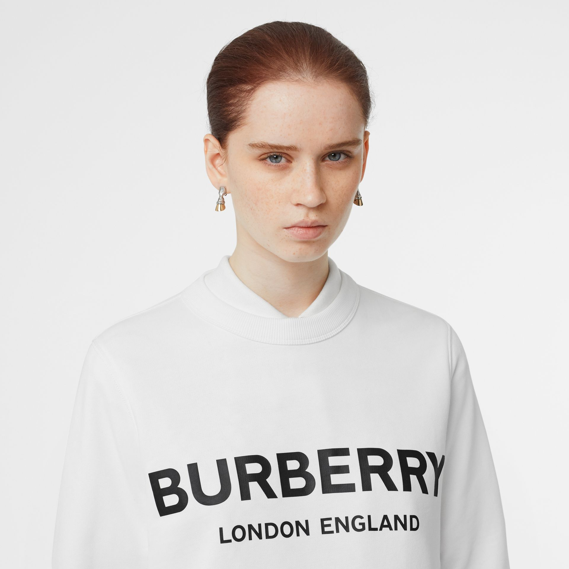 Logo Print Cotton Sweatshirt in White - Women | Burberry Australia - gallery image 1