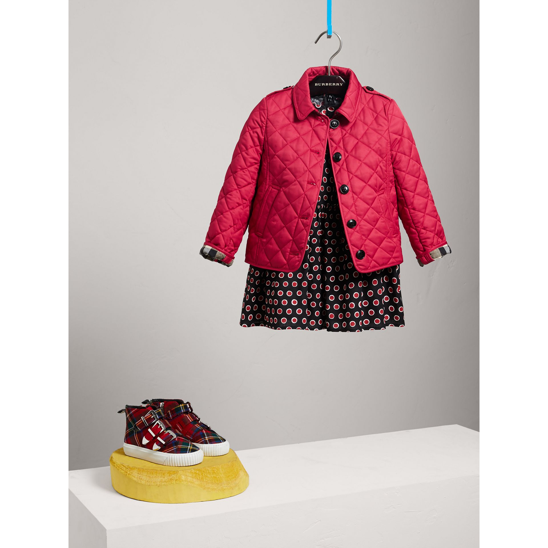 Check Lined Diamond Quilted Jacket in Crimson Pink - Girl | Burberry - gallery image 0