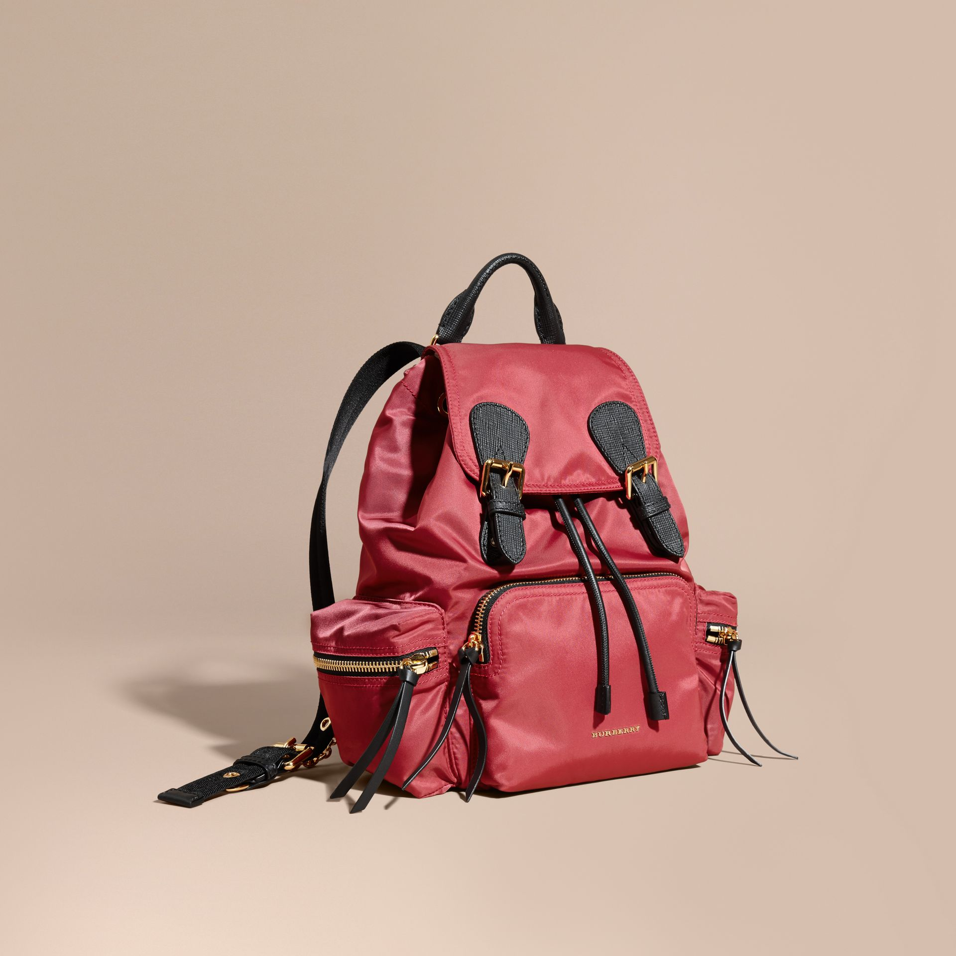 The Medium Rucksack in Technical Nylon and Leather in Plum Pink - gallery image 1