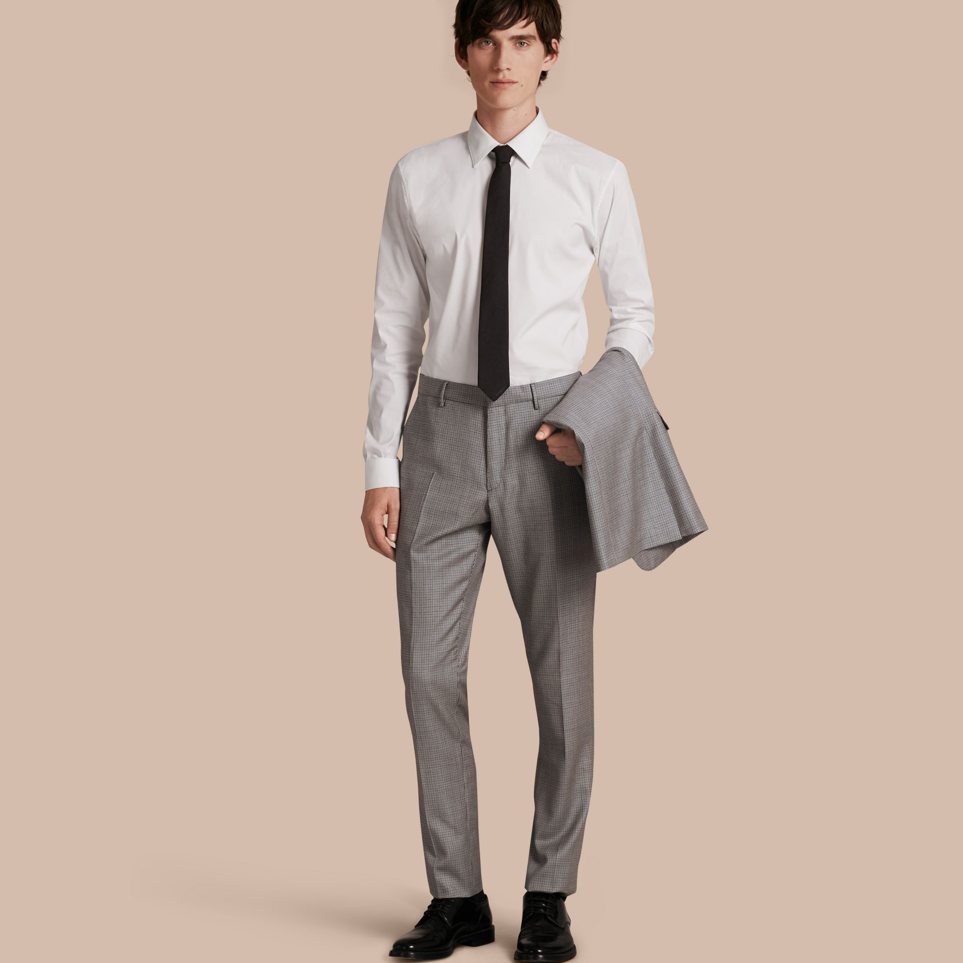 Slim Fit Houndstooth Wool Trousers in Light Blue - Men | Burberry - gallery image 1