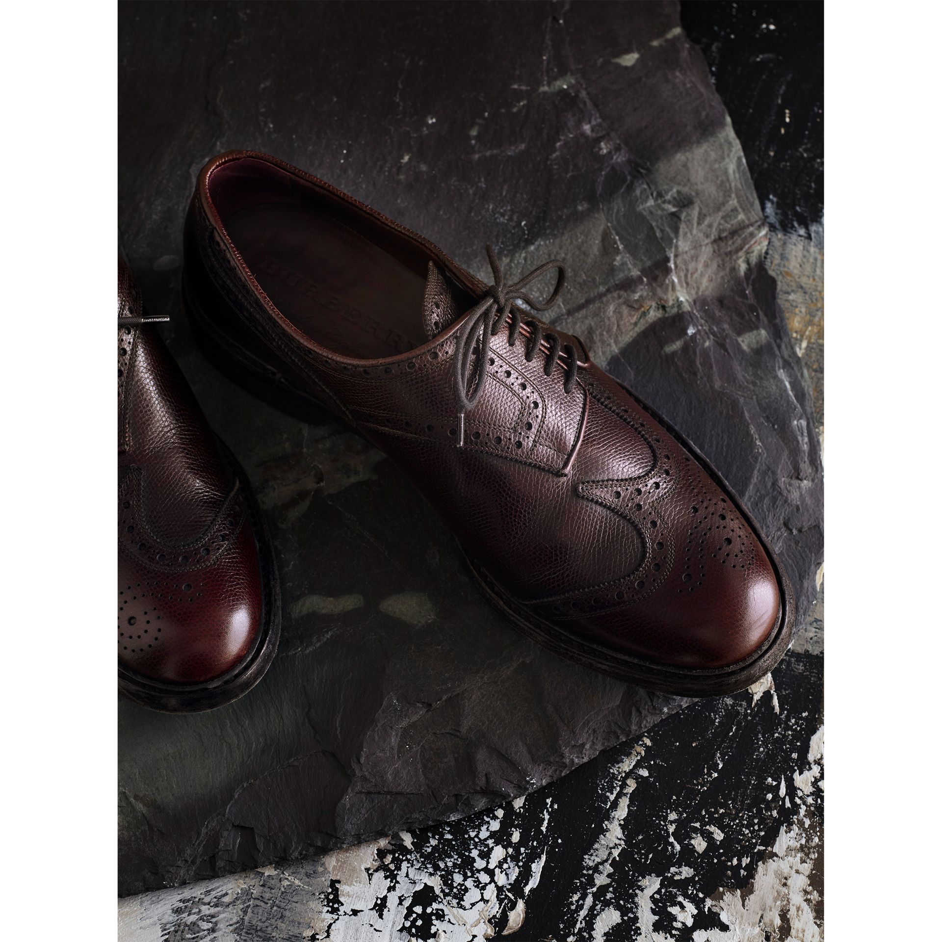 Leather Brogues with Asymmetric Closure in Burgundy - Men | Burberry - gallery image 1