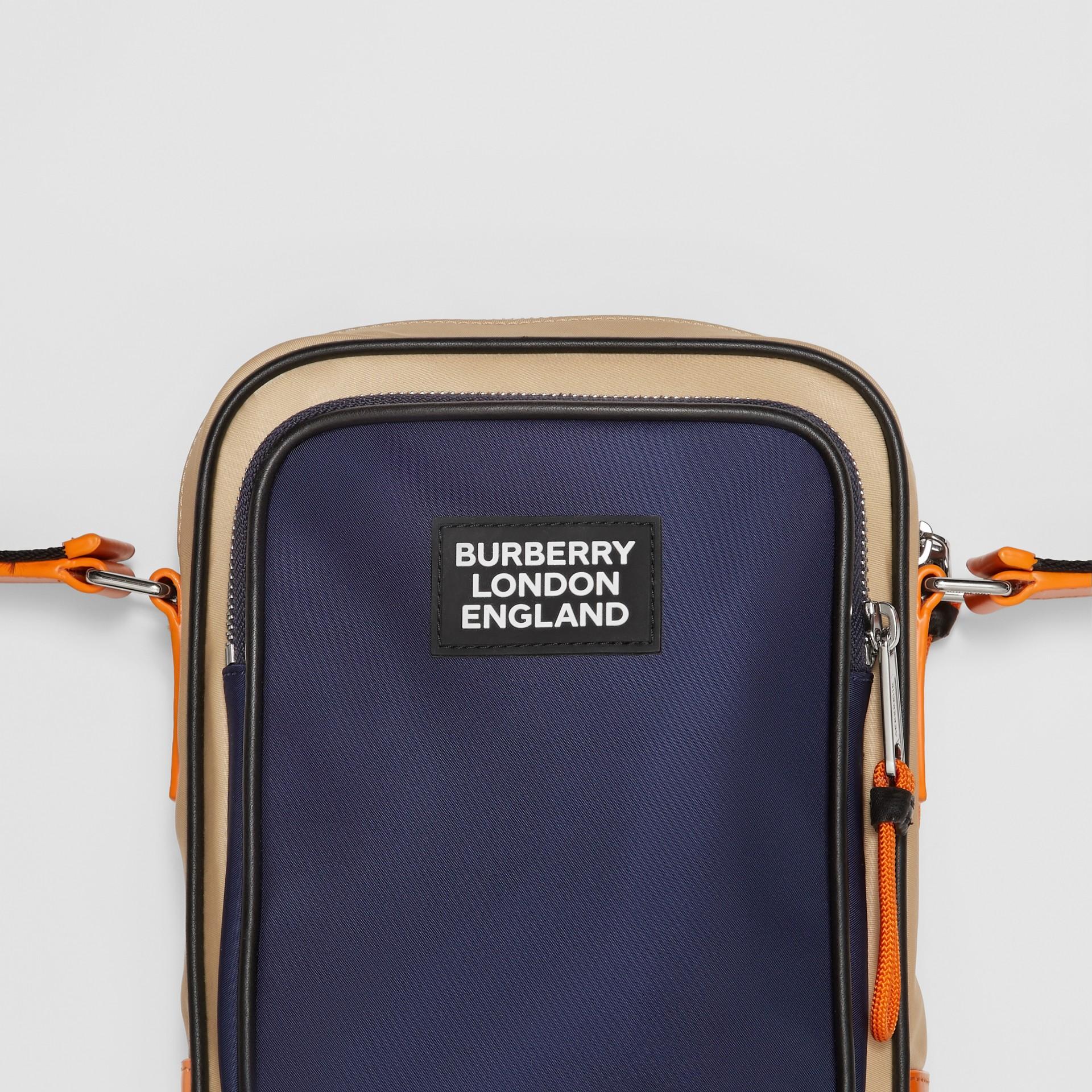 Logo Appliqué Two-tone ECONYL® Crossbody Bag in Regency Blue/bright Orange - Men | Burberry United Kingdom - gallery image 1