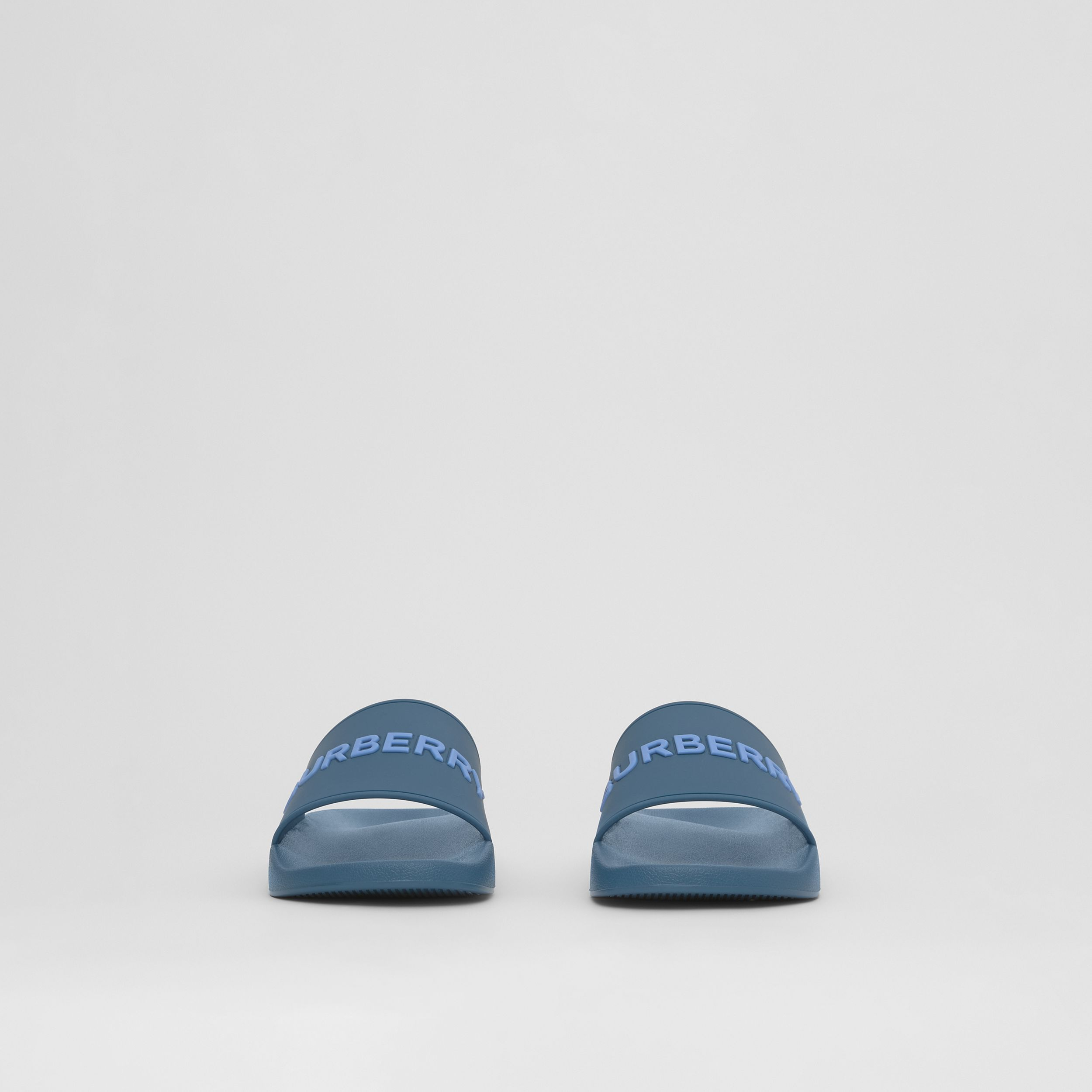 Embossed Logo Slides in Dark Cerulean Blue - Men | Burberry United Kingdom - 4