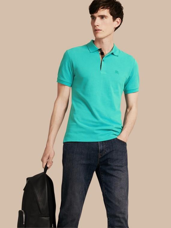 Poloshirt aus Baumwollpiqué mit Check-Knopfleiste Türkisgrün