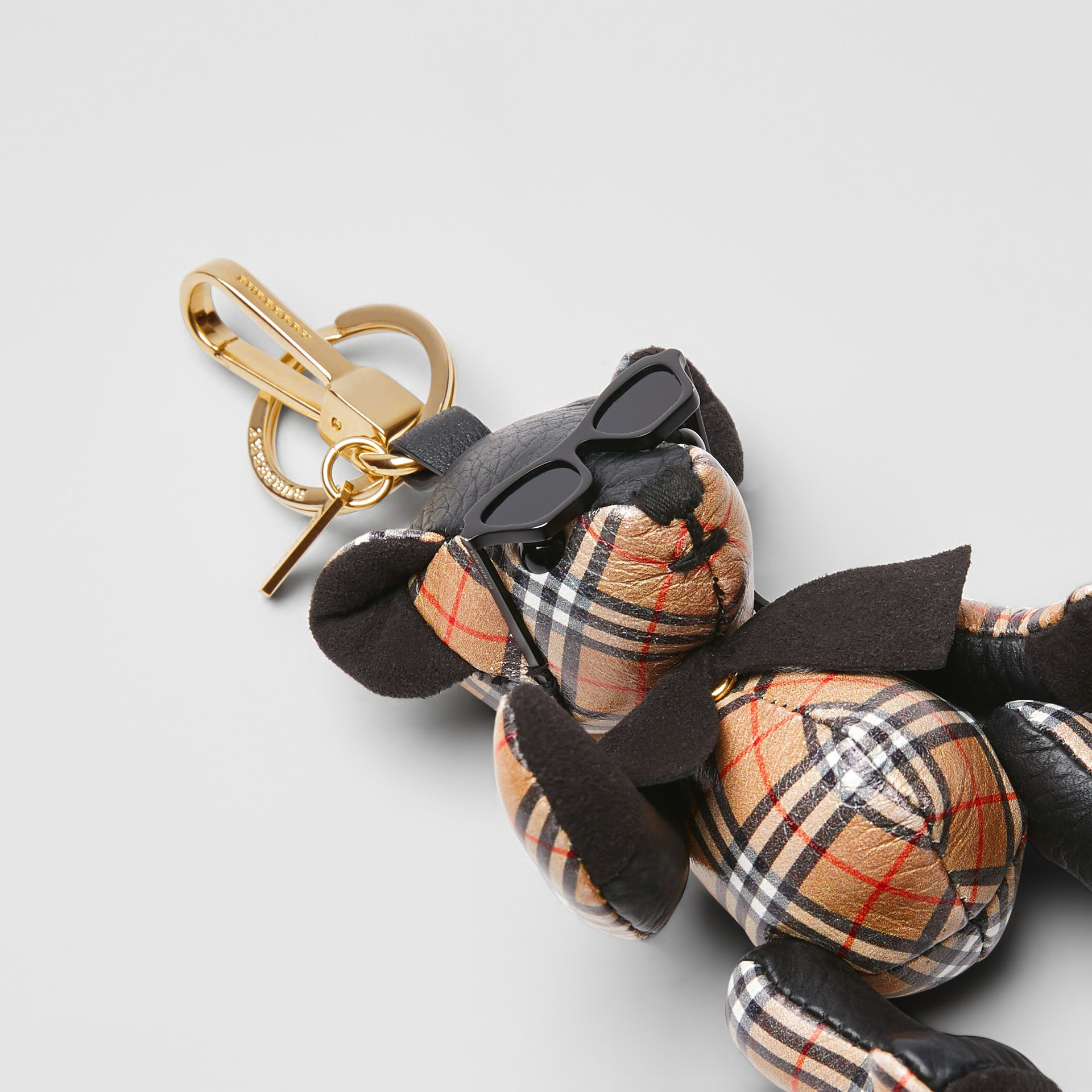 Thomas Bear Charm in Sunglasses in Black/antique Yellow | Burberry United Kingdom - gallery image 1
