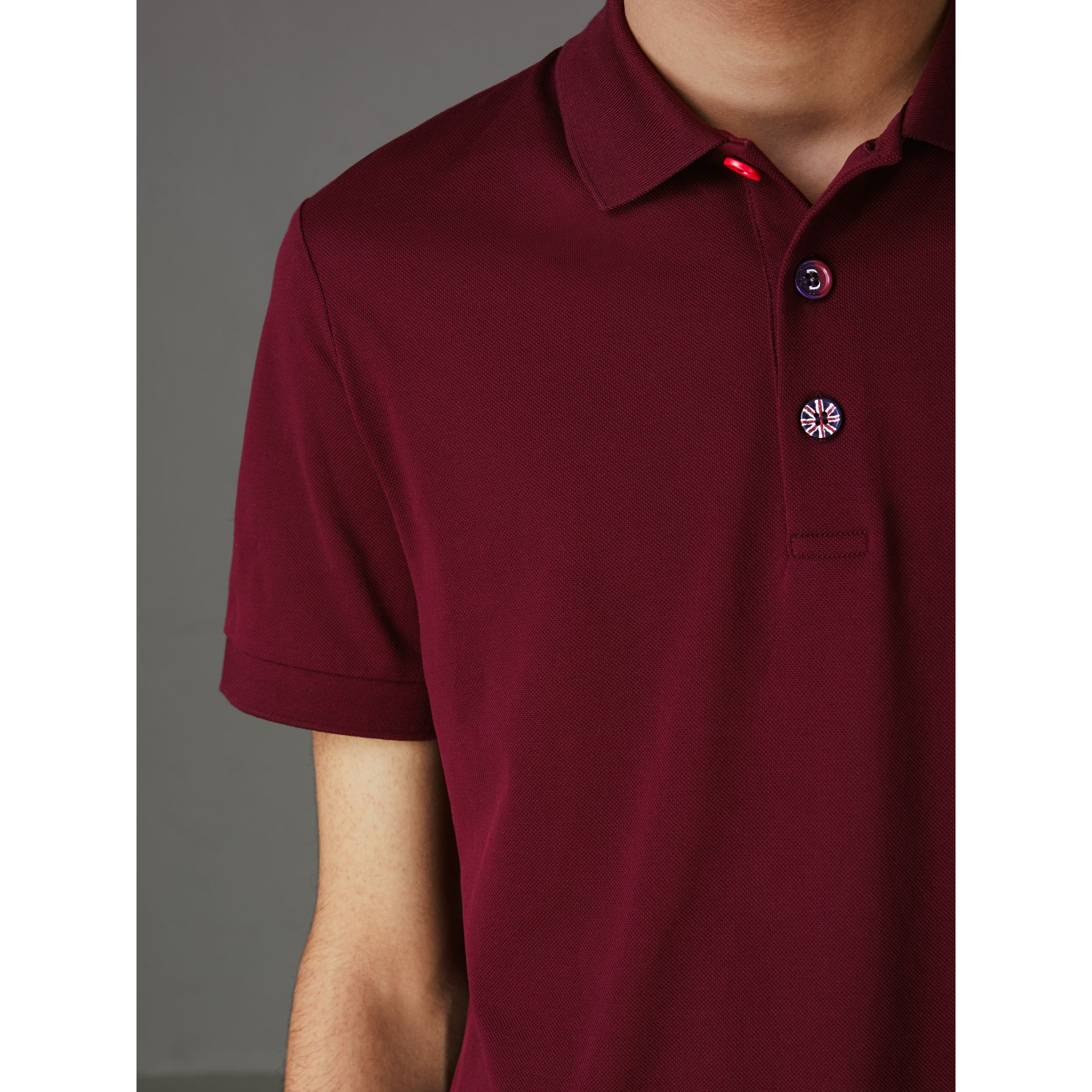 Painted Button Cotton Piqué Polo Shirt in Burgundy Red - Men | Burberry Australia - gallery image 1