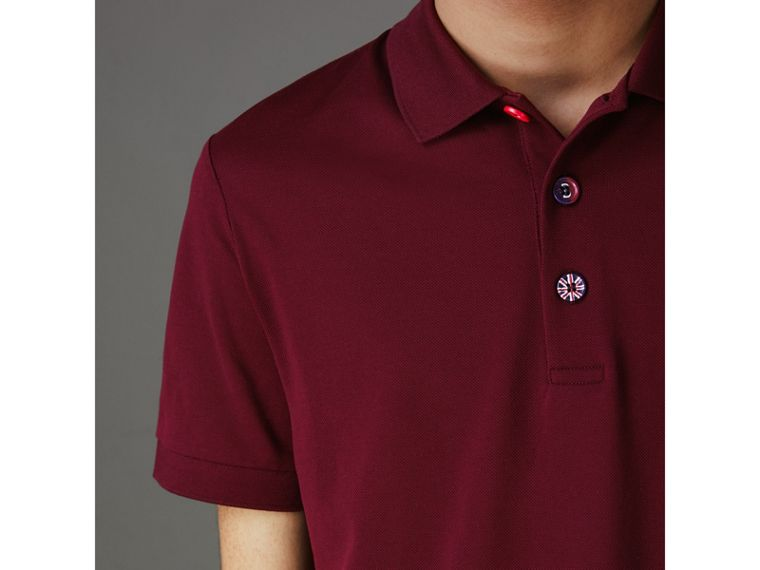 Painted Button Cotton Piqué Polo Shirt in Burgundy Red - Men | Burberry Canada - cell image 1