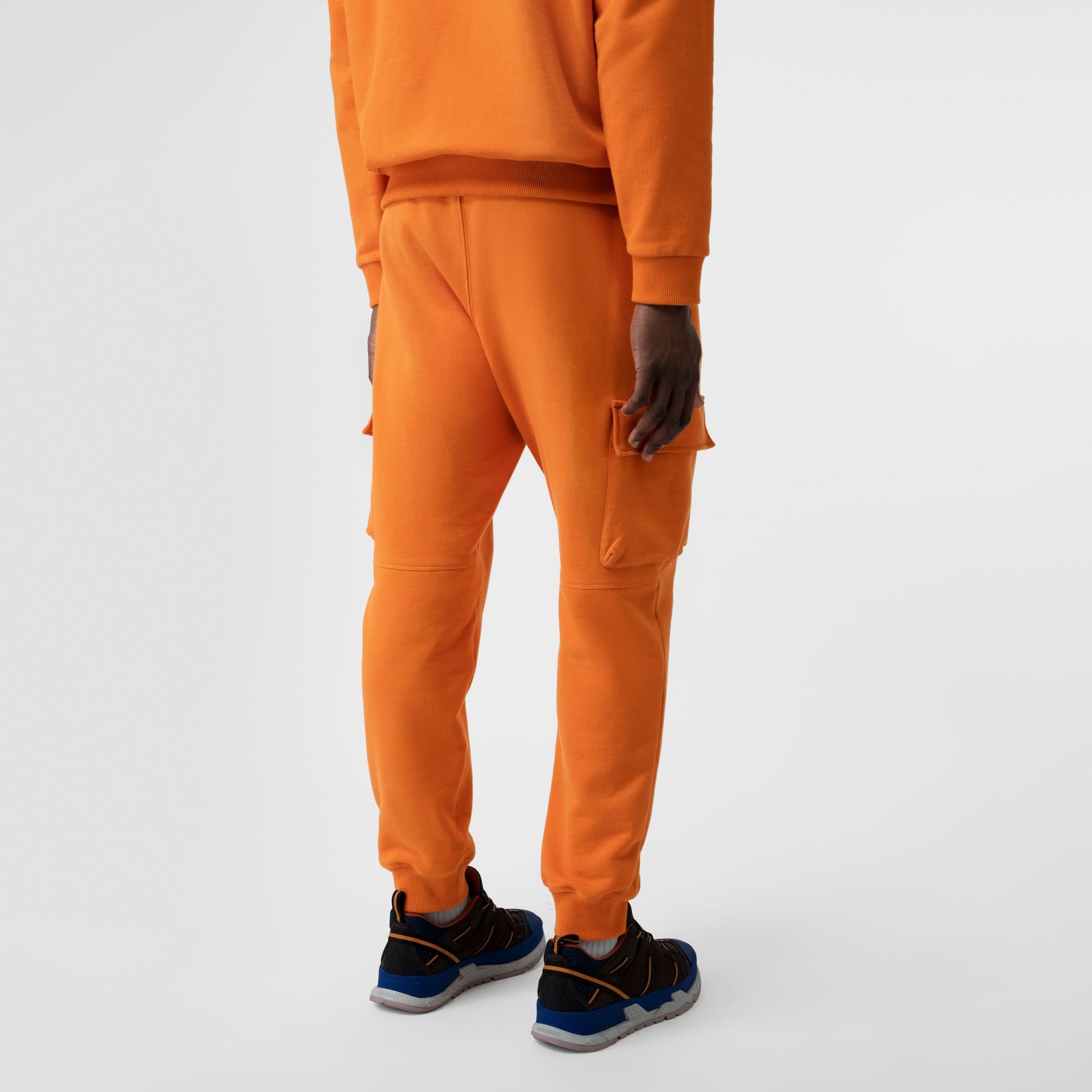 Logo Print Cotton Trackpants in Bright Orange - Men | Burberry - gallery image 2