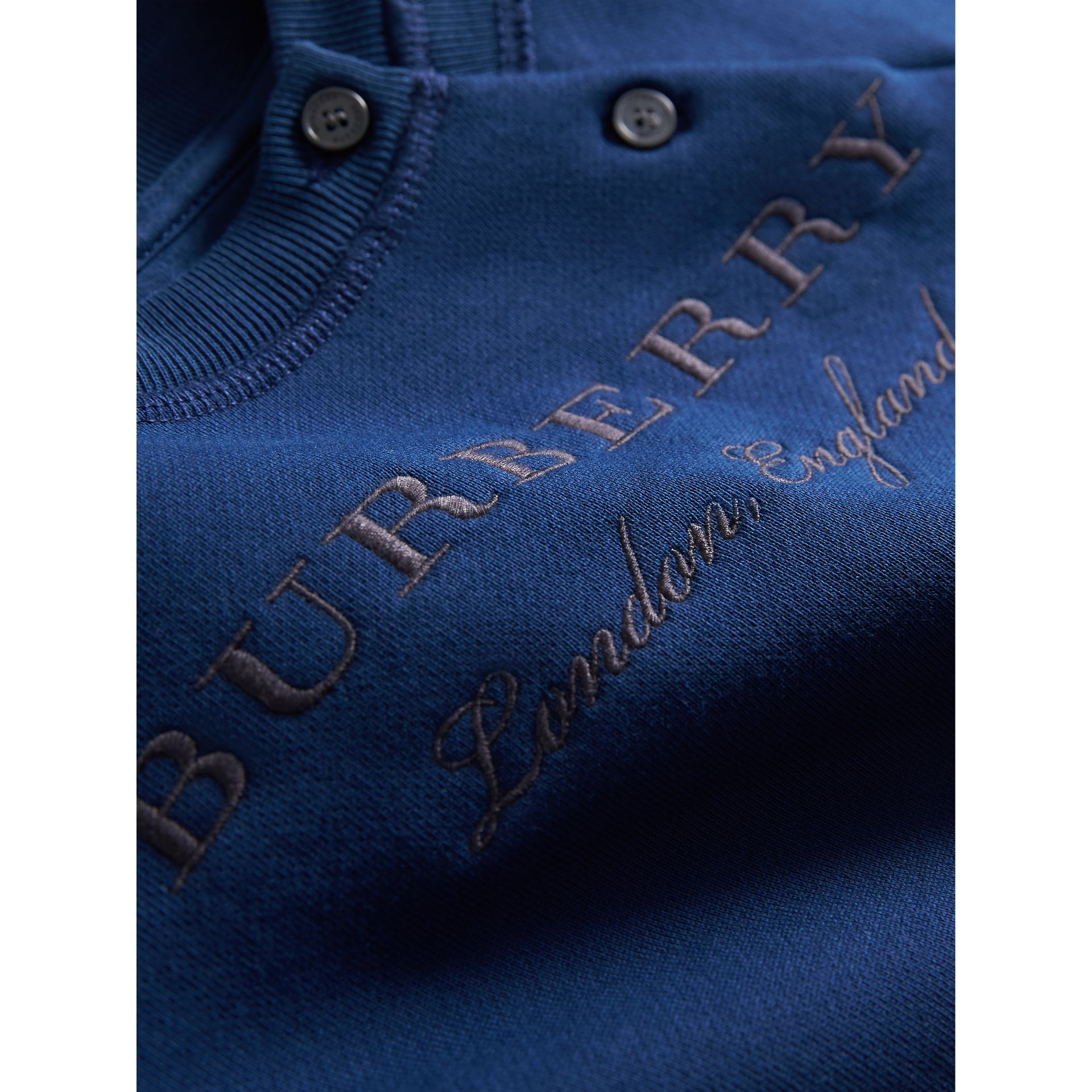 Contrast Stripe Embroidered Cotton Sweatshirt in Canvas Blue | Burberry - gallery image 1