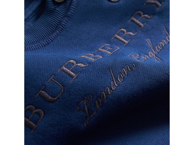 Contrast Stripe Embroidered Cotton Sweatshirt in Canvas Blue | Burberry - cell image 1