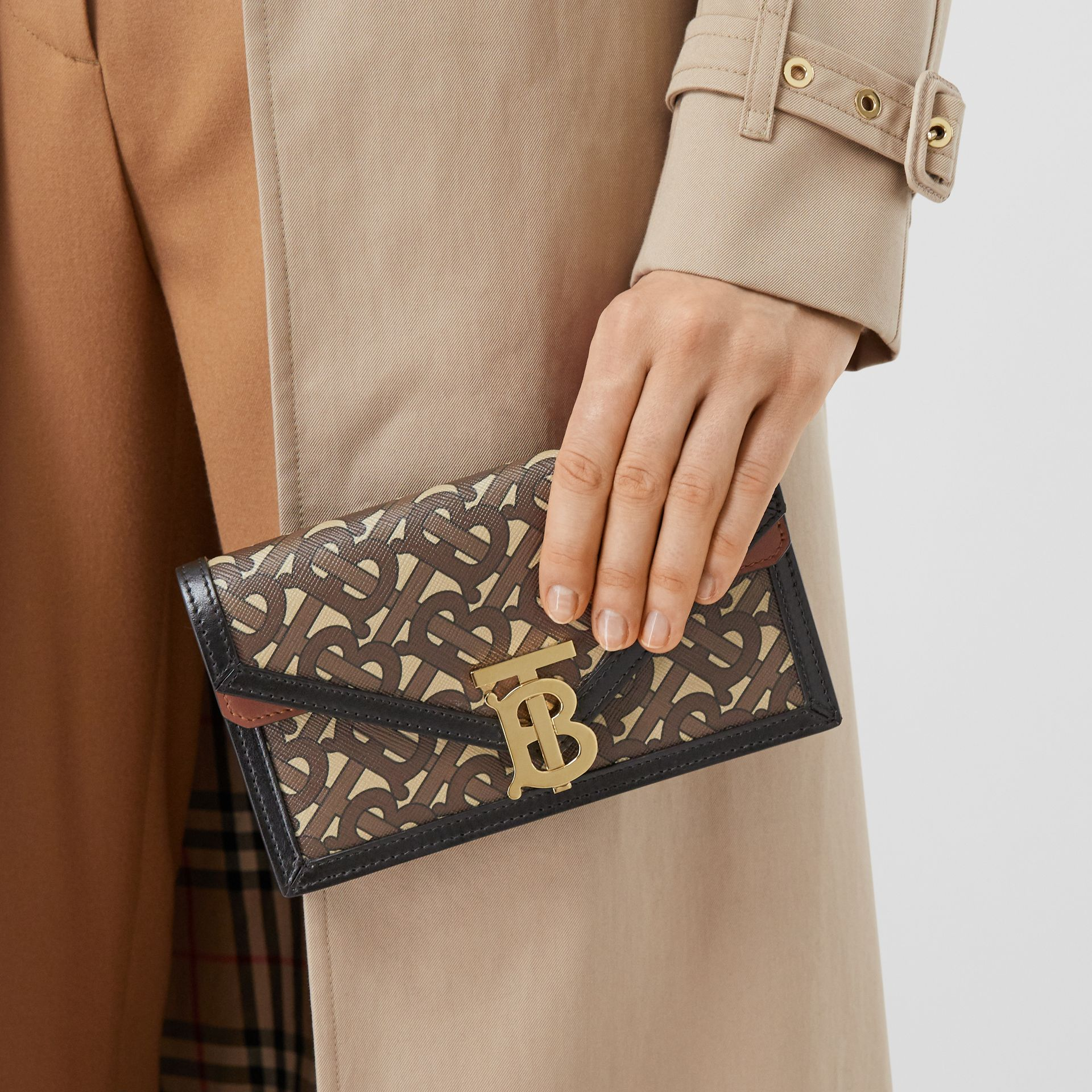 Belted Monogram E-canvas TB Envelope Clutch in Bridle Brown - Women | Burberry - gallery image 1