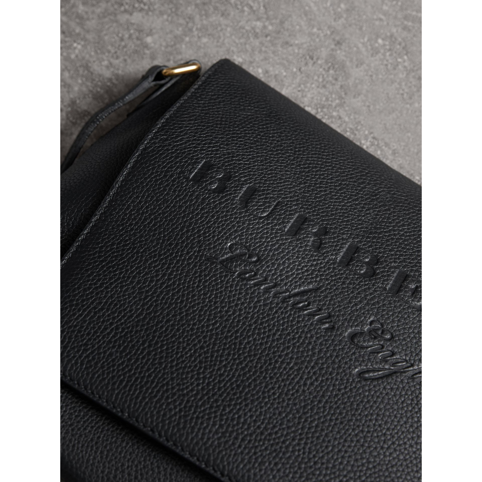 Medium Embossed Leather Messenger Bag in Black | Burberry - gallery image 1