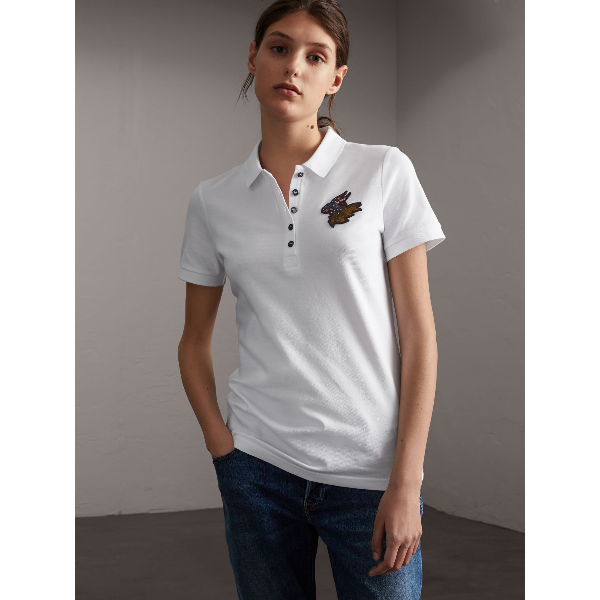 Beasts Motif Stretch Cotton Piqué Polo Shirt in White - Women | Burberry Canada - gallery image 1