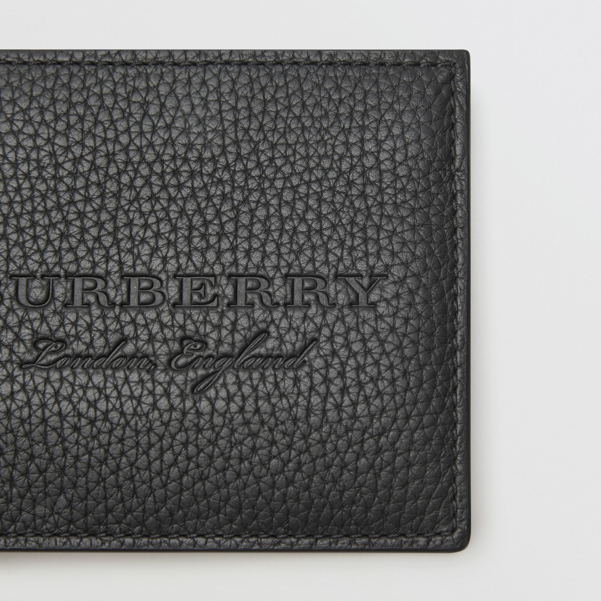 Embossed Leather Bifold Wallet in Black - Men | Burberry - gallery image 1